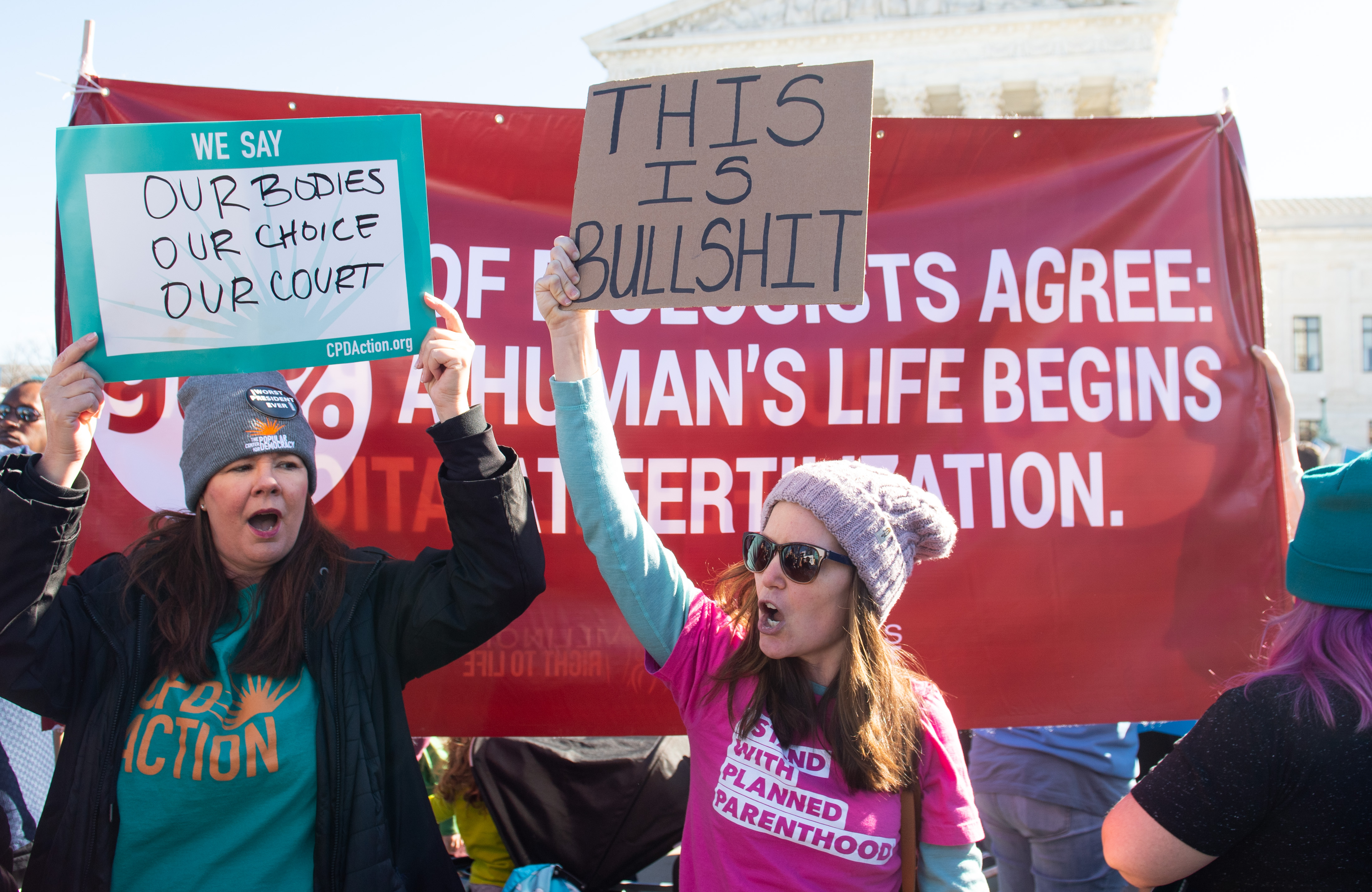Anti-abortion protesters and pro-choice activists supporting legal access to abortion protest alongside each other during a demonstration outside the US Supreme Court in Washington, DC, March 4, 2020, as the Court hears oral arguments regarding a Louisiana law about abortion access in the first major abortion case in years. - The United States Supreme Court on Wednesday will hear what may be its most significant case in decades on the controversial subject of abortion. At issue is a state law in Louisiana which requires doctors who perform abortions to have admitting privileges at a nearby hospital. (Photo by SAUL LOEB / AFP) (Photo by SAUL LOEB/AFP via Getty Images)