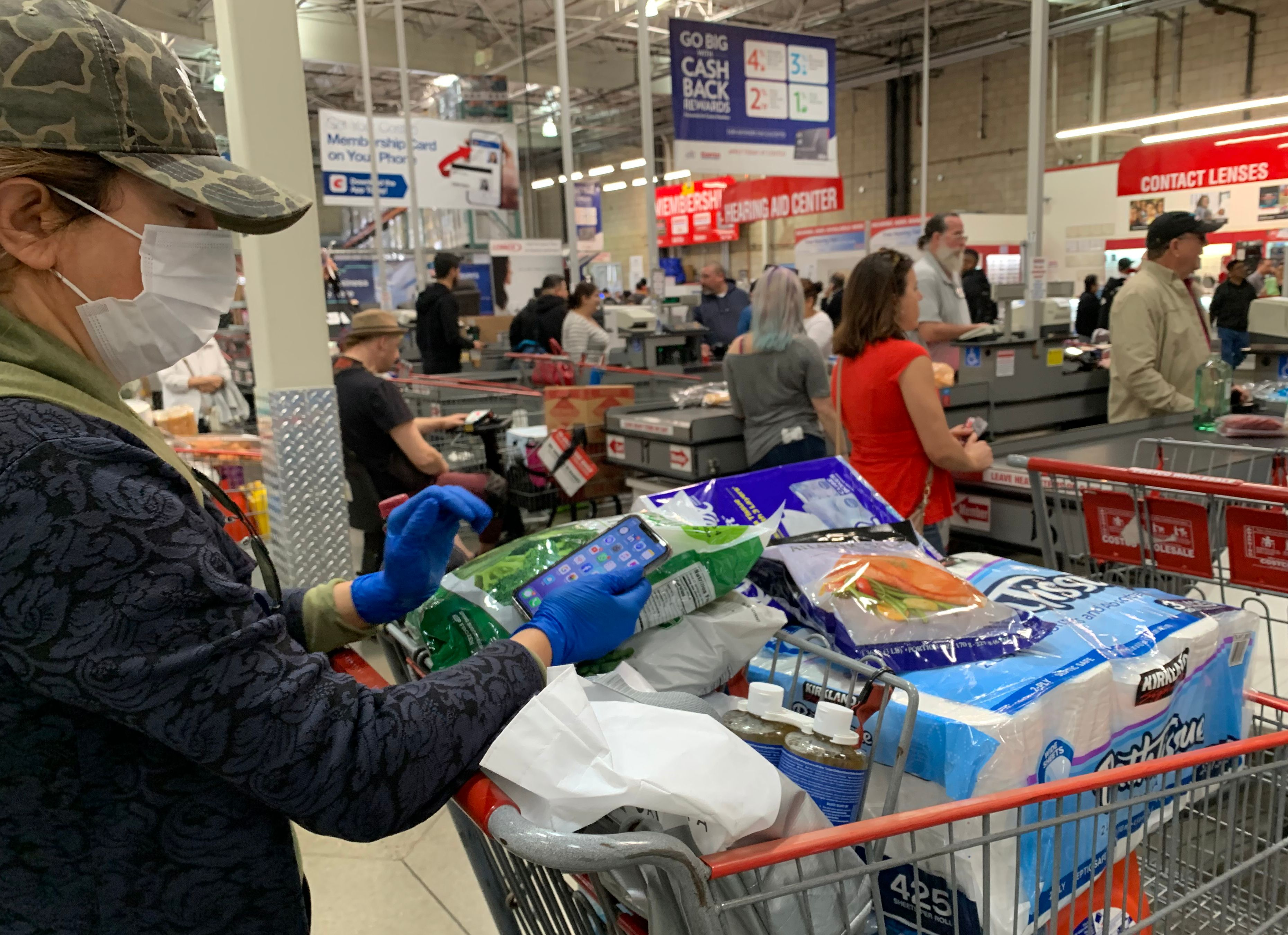 Customers wait in line to buy water and other supplies, on fears that the coronavirus, COVID-19, will spread and force people to stay indoors, at a Costco in Burbank, California on March 6, 2020. - US lawmakers passed an emergency USD 8.3 billion spending bill to combat the coronavirus on Thursday as the number of cases surged in the country's northwest and deaths reached 12. Since then the toll has risen to 12 and the virus has spread to at least 15 states -- the latest being Maryland adjacent to the nation's capital Washington. (Photo by Robyn BECK / AFP) (Photo by ROBYN BECK/AFP via Getty Images)