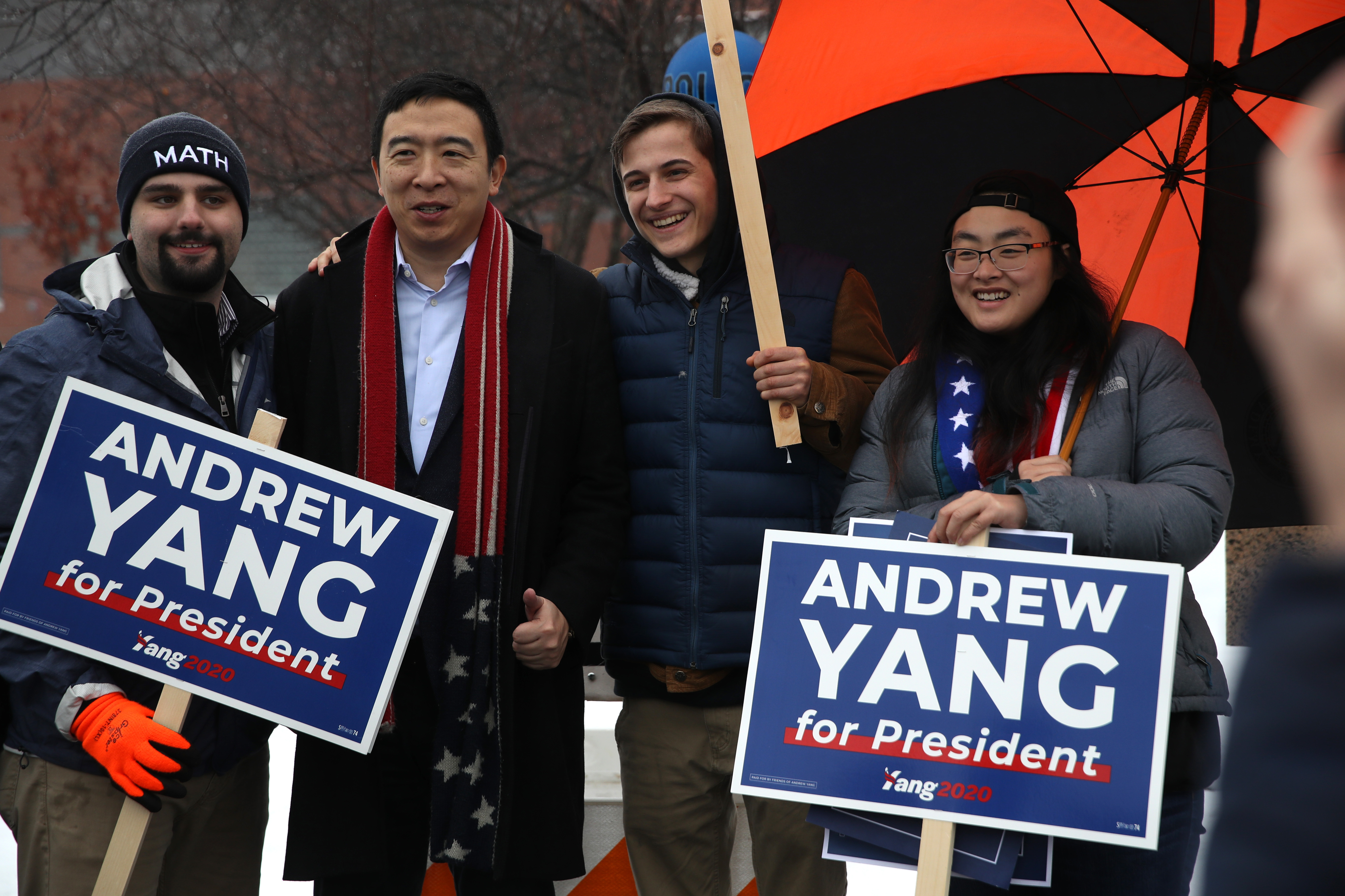 KEENE, NEW HAMPSHIRE - FEBRUARY 11: Democratic presidential candidate Andrew Yang take a photo with supporters who are holding campaign signs in front of a polling station on February 11, 2020 in Keene, New Hampshire. New Hampshire holds its first in the nation primary today. (Photo by Justin Sullivan/Getty Images)