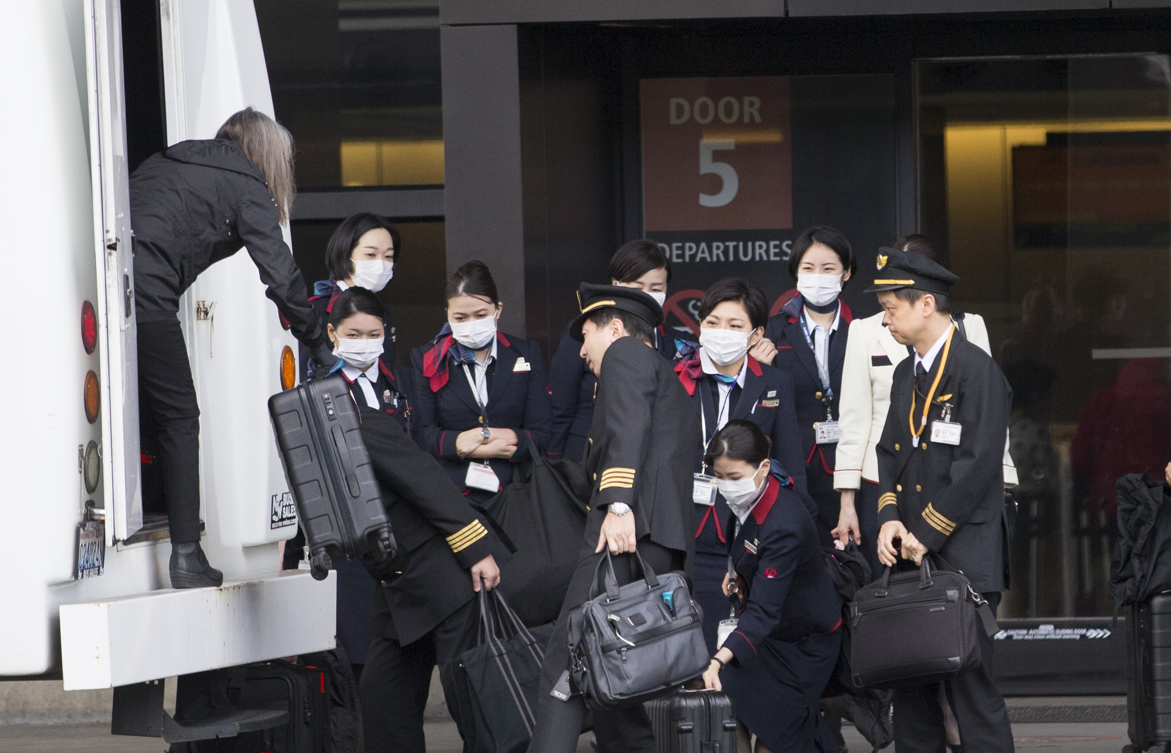 An international airlines crew arrives at the departure gate at SeattleTacoma International Airport (also known as Sea-Tac Airport) on March 8, 2020 in Seattle, Washington. (Karen Ducey/Getty Images)