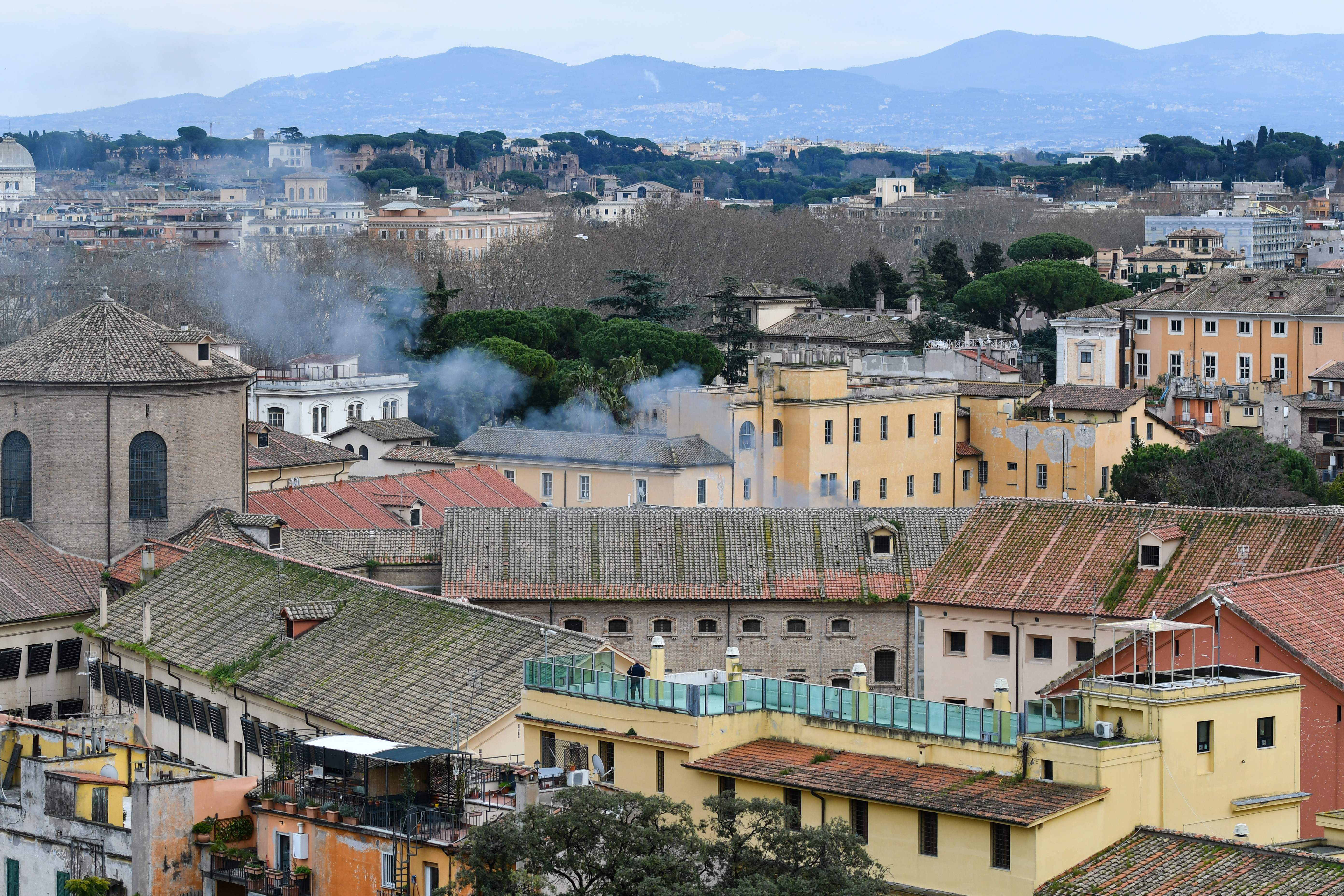 Smoke billows from a rooftop of the Regina Coeli prison in central Rome on March 9, 2020. (ALBERTO PIZZOLI/AFP via Getty Images)