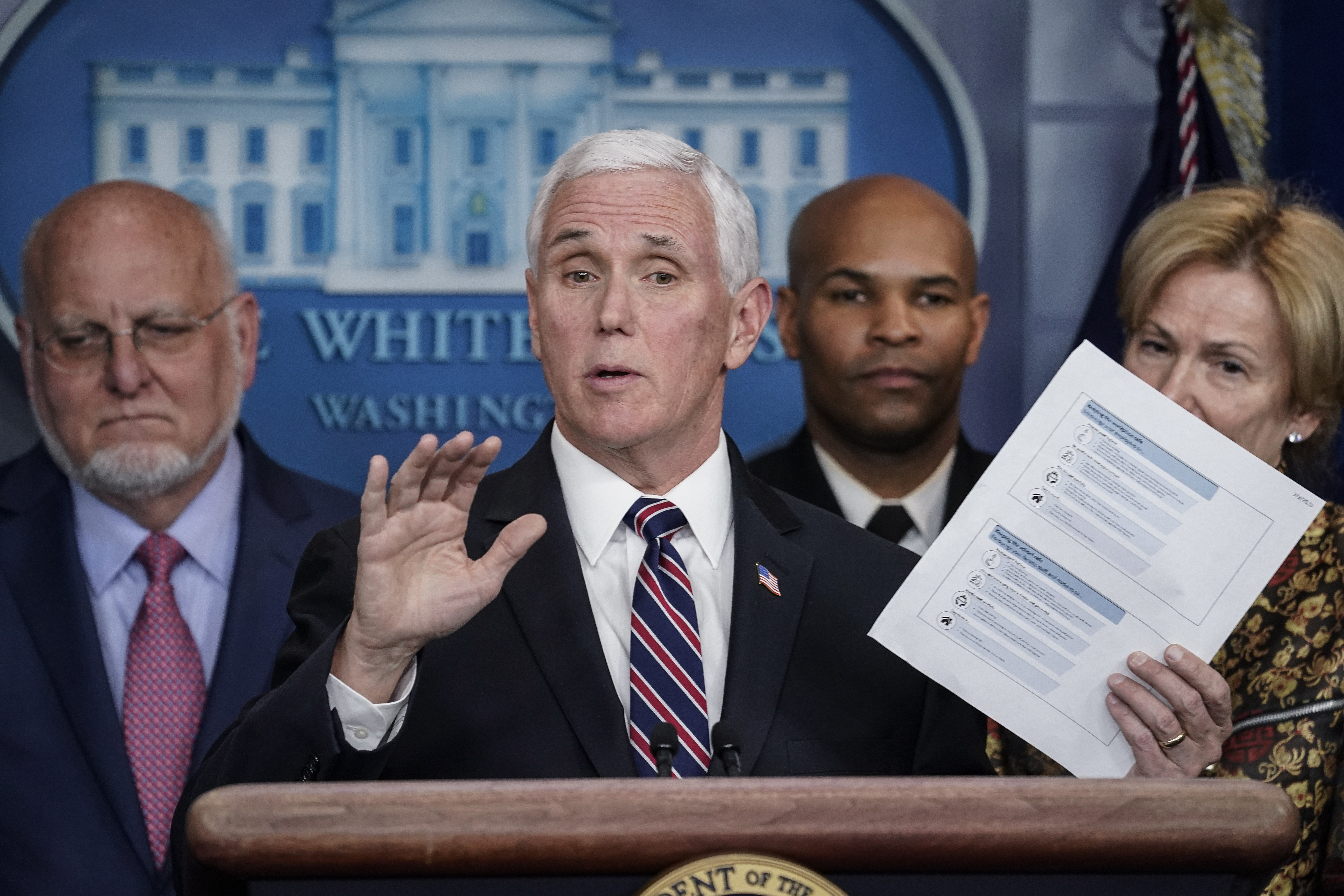 WASHINGTON, DC - MARCH 09: U.S. Vice President Mike Pence holds up a copy of community health guidelines during a press briefing with members of the White House Coronavirus Task Force team in the press briefing room of the White House March 9, 2020 in Washington, DC. Also pictured, from L-R, Robert Redfield, Director of the Centers for Disease Control and Prevention, U.S. Surgeon General Dr. Jerome Adams, and task force leader Debbie Birx. President Trump said he will hold a press conference on Tuesday concerning COVID-19 and other topics. (Photo by Drew Angerer/Getty Images)
