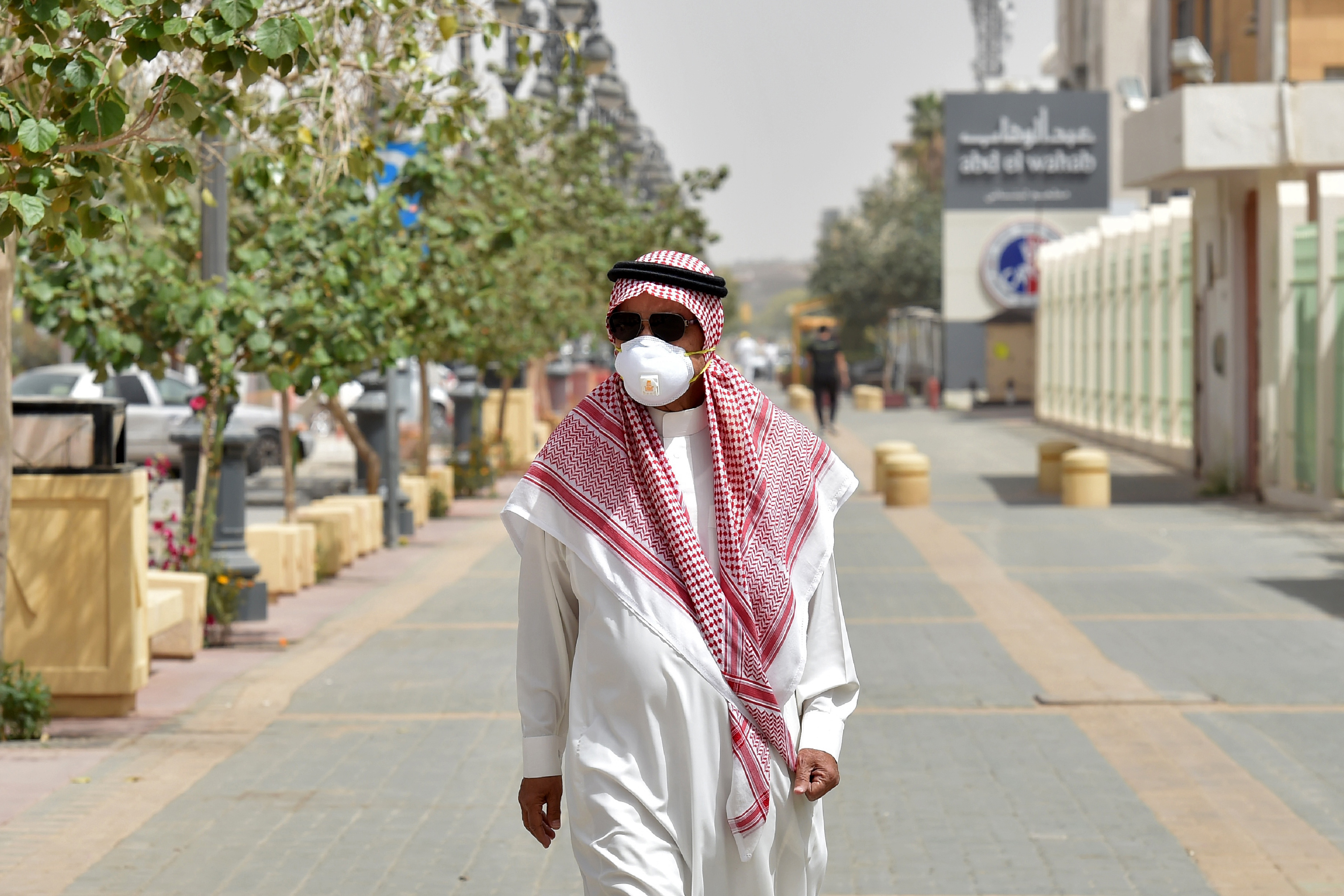A Saudi man, wearing a protective mask as a precaution against COVID-19 coronavirus disease, walks along Tahlia street in the centre of the capital Riyadh on March 15, 2020. (Photo by FAYEZ NURELDINE / AFP) (Photo by FAYEZ NURELDINE/AFP via Getty Images)