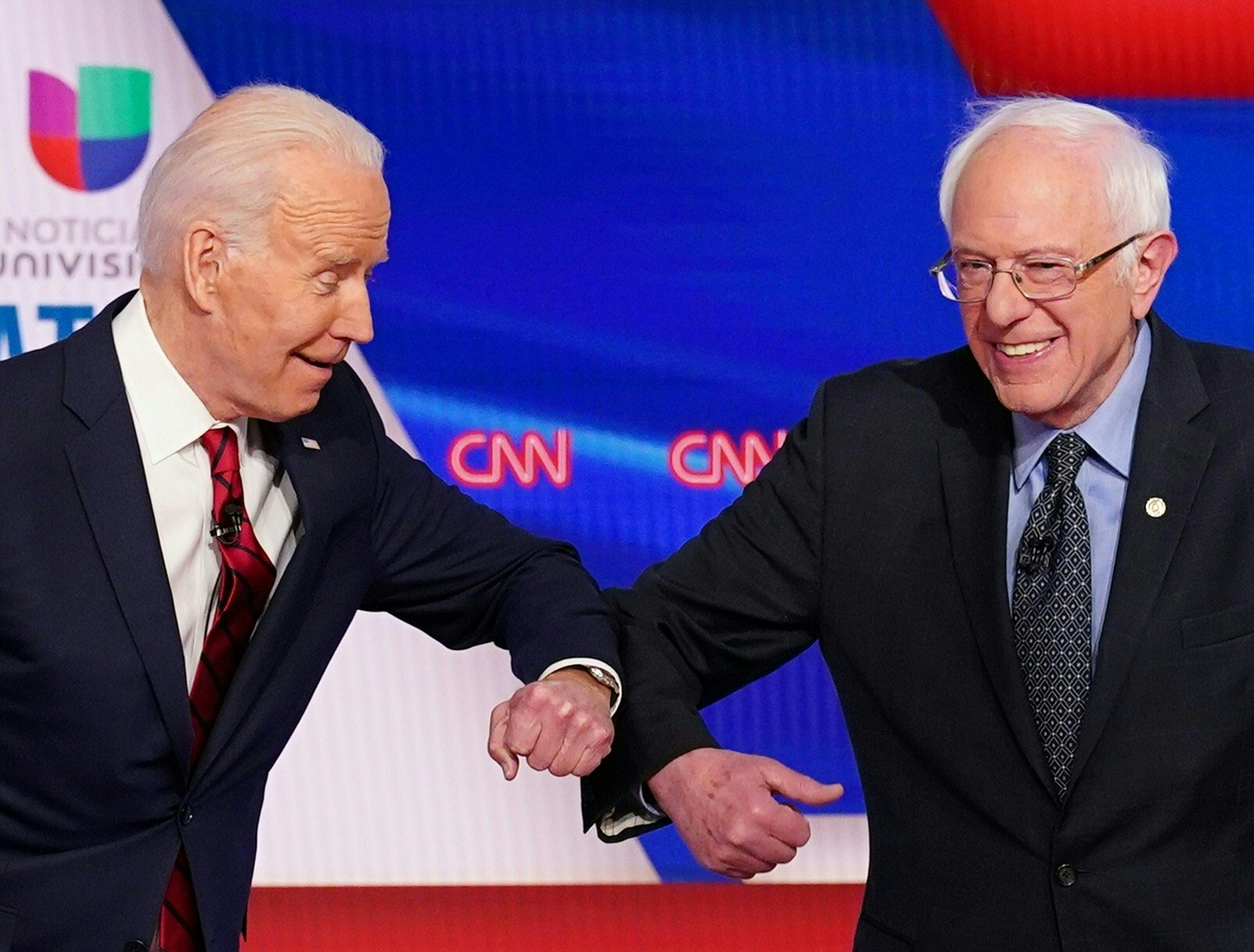 Democratic presidential hopefuls former US vice president Joe Biden (L) and Senator Bernie Sanders greet each other with a safe elbow bump before the start of the 11th Democratic Party 2020 presidential debate in a CNN Washington Bureau studio in Washington, DC on March 15, 2020. (Photo by MANDEL NGAN/AFP via Getty Images)