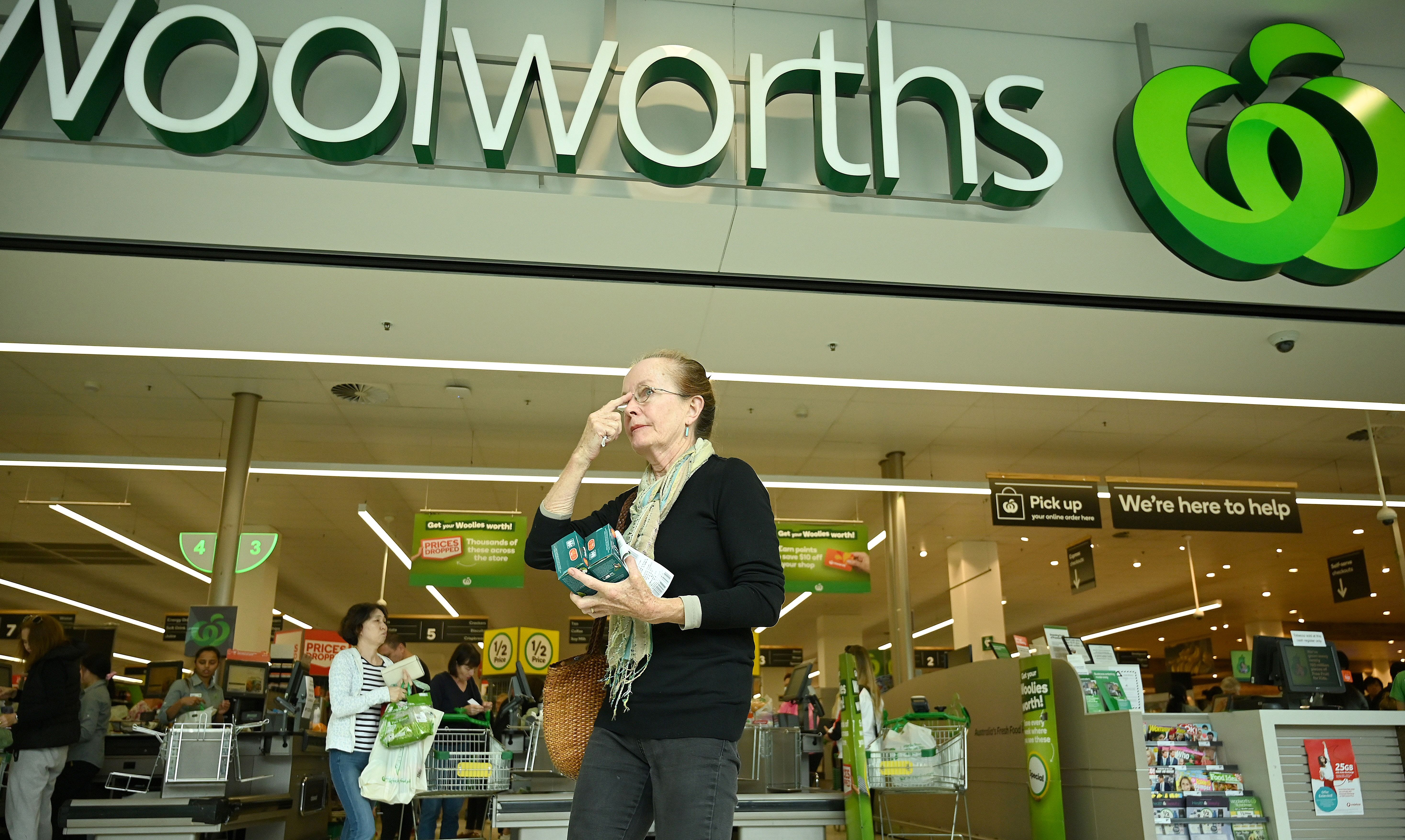 An elderly woman shops at a Woolworths supermarket in Sydney on March 17, 2020. (PETER PARKS/AFP via Getty Images)