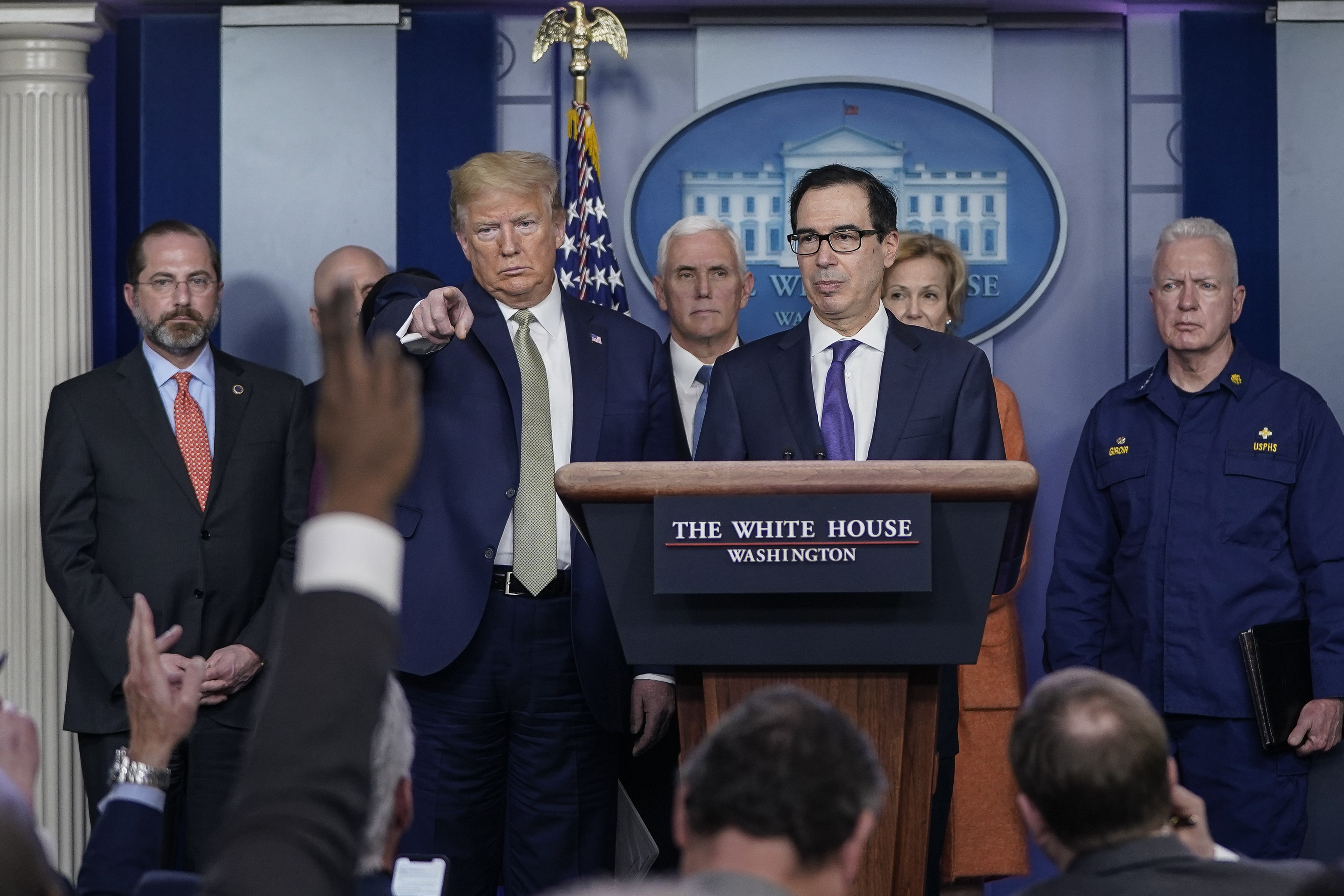 WASHINGTON, DC - MARCH 17: U.S. President Donald Trump and Treasury Secretary Steven Mnuchin, joined by members of the Coronavirus Task Force, field questions about the coronavirus outbreak in the press briefing room at the White House on March 17, 2020 in Washington, DC. The Trump administration is considering an $850 billion stimulus package to counter the economic fallout as the coronavirus spreads. (Photo by Drew Angerer/Getty Images)