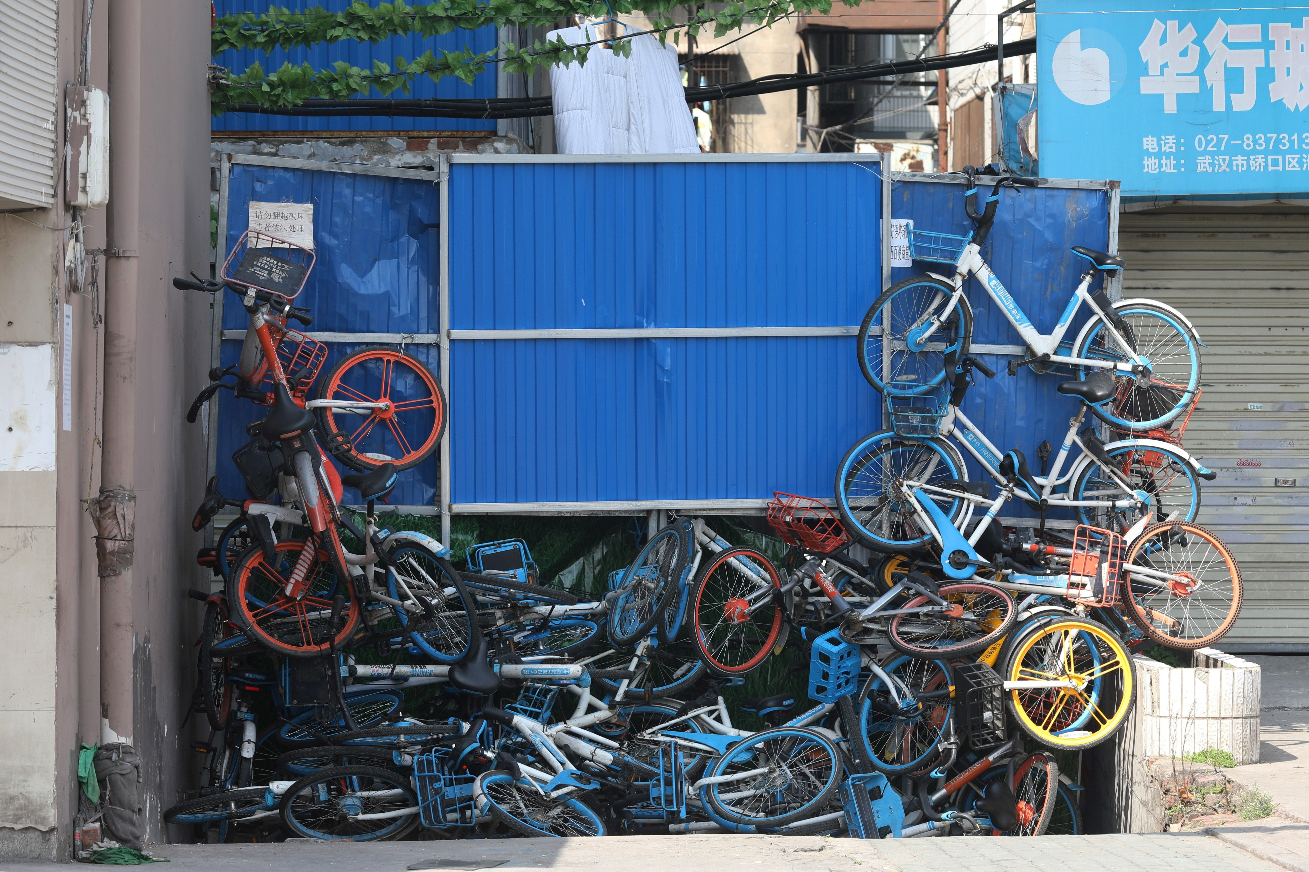 This photo taken on March 17, 2020 shows a barrier made from steel and piled-up shared bicycles in a street in Wuhan, in China's central Hubei province.(Photo by STR/AFP via Getty Images)