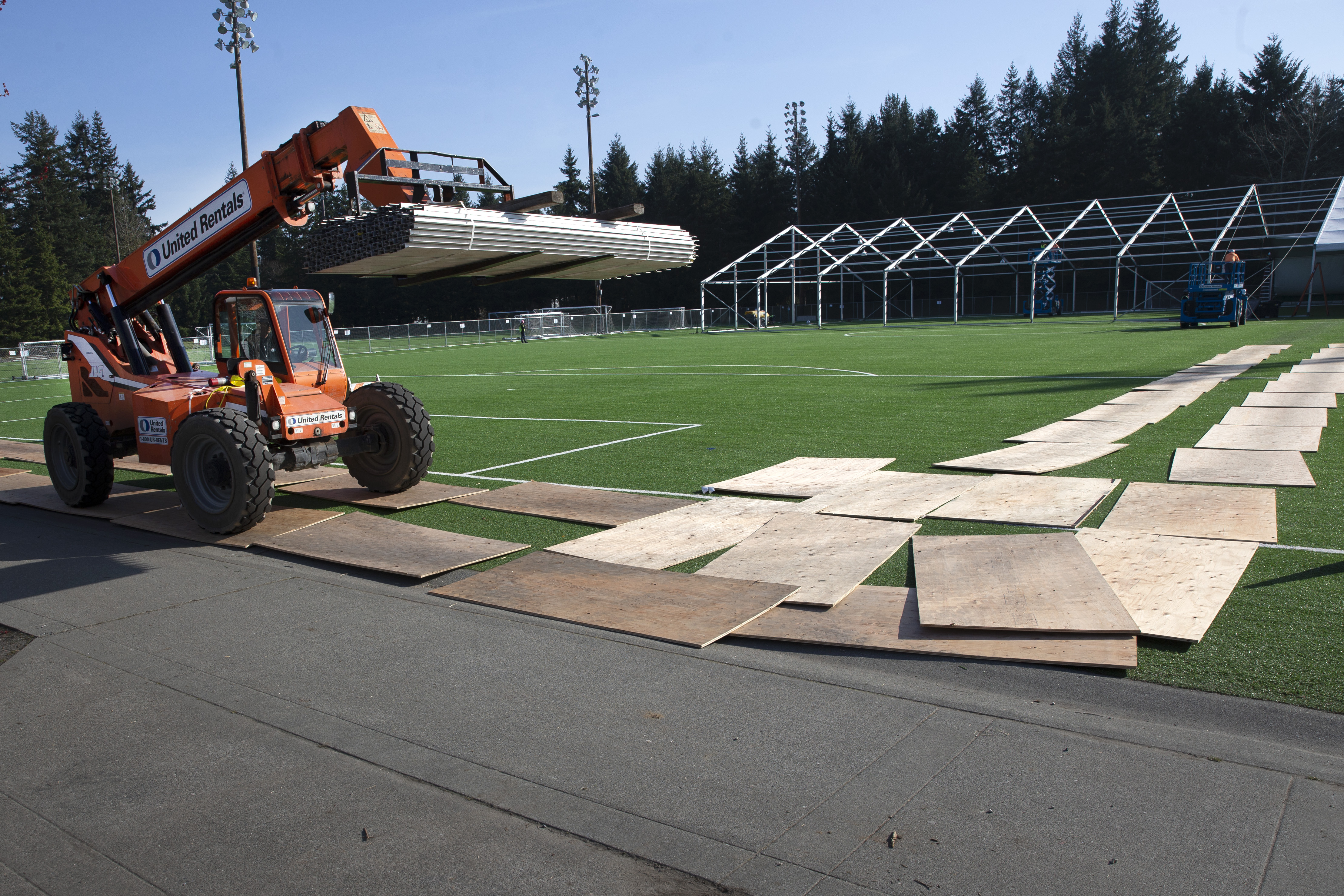 SHORELINE, WA - MARCH 19: Workers build a temporary field hospital on a soccer field for people ill with the novel coronavirus so they can isolate and recover on March 19, 2020 in Shoreline, Washington. (Photo by Karen Ducey/Getty Images)