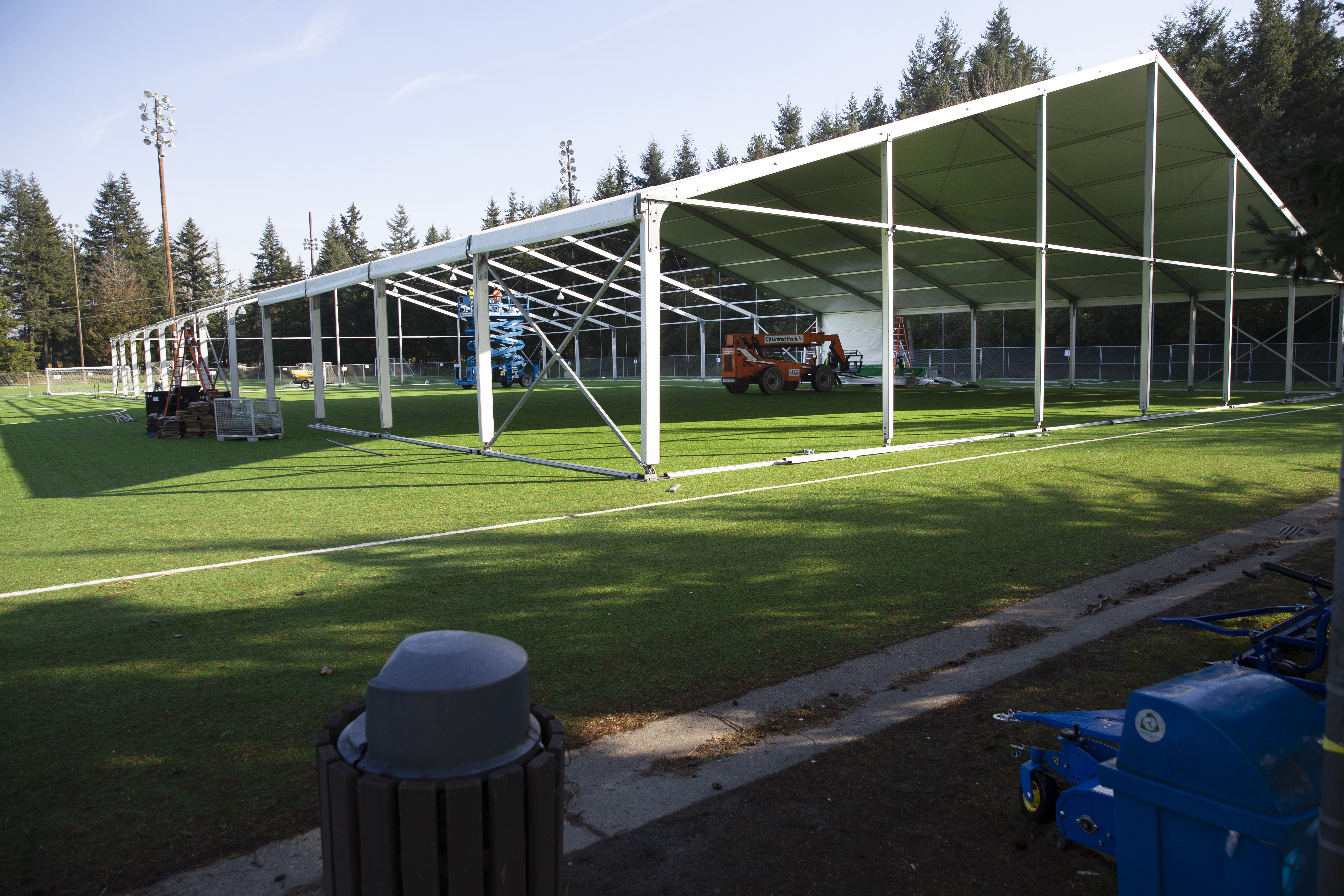 SHORELINE, WA - MARCH 19: Workers build a temporary field hospital on a soccer field for people ill with the novel coronavirus so they can isolate and recover on March 19, 2020 in Shoreline, Washington. The 200 bed field hospital will increase hospital capacity and help curb the spread of COVID-19. (Photo by Karen Ducey/Getty Images)