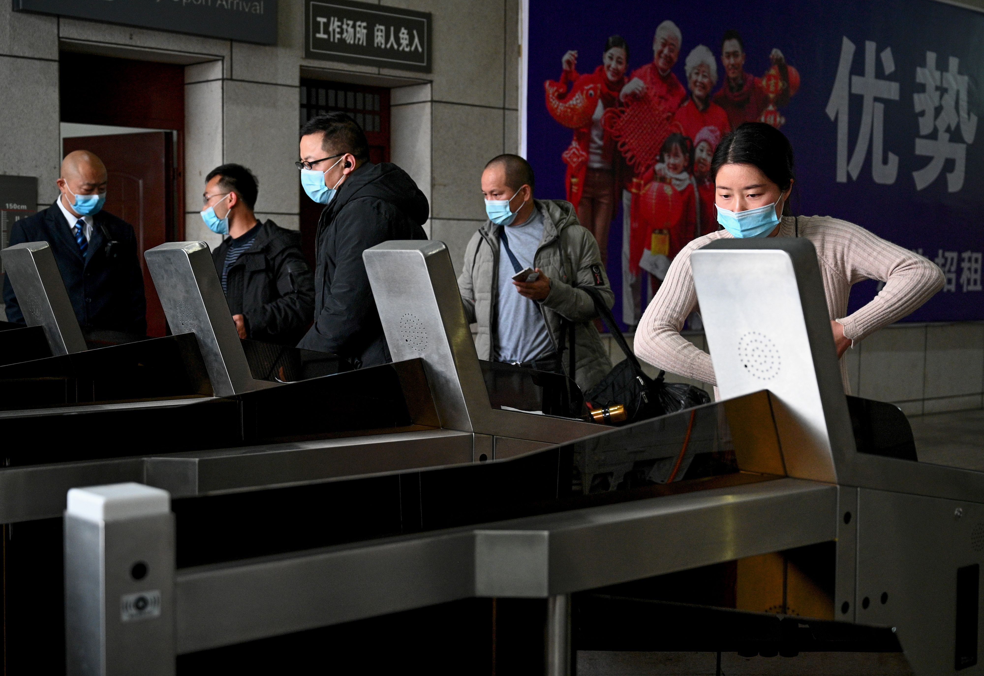 Passengers wearing facemasks arrive at the Macheng railway station, after a months-long lockdown as a preventive measure against the COVID-19 coronavirus, in Macheng in Chinas central Hubei province on March 25, 2020. - China lifted tough restrictions on the province at the epicentre of the coronavirus outbreak on March 25 after a months-long lockdown as the country reported no new domestic cases. (Photo by NOEL CELIS/AFP via Getty Images)