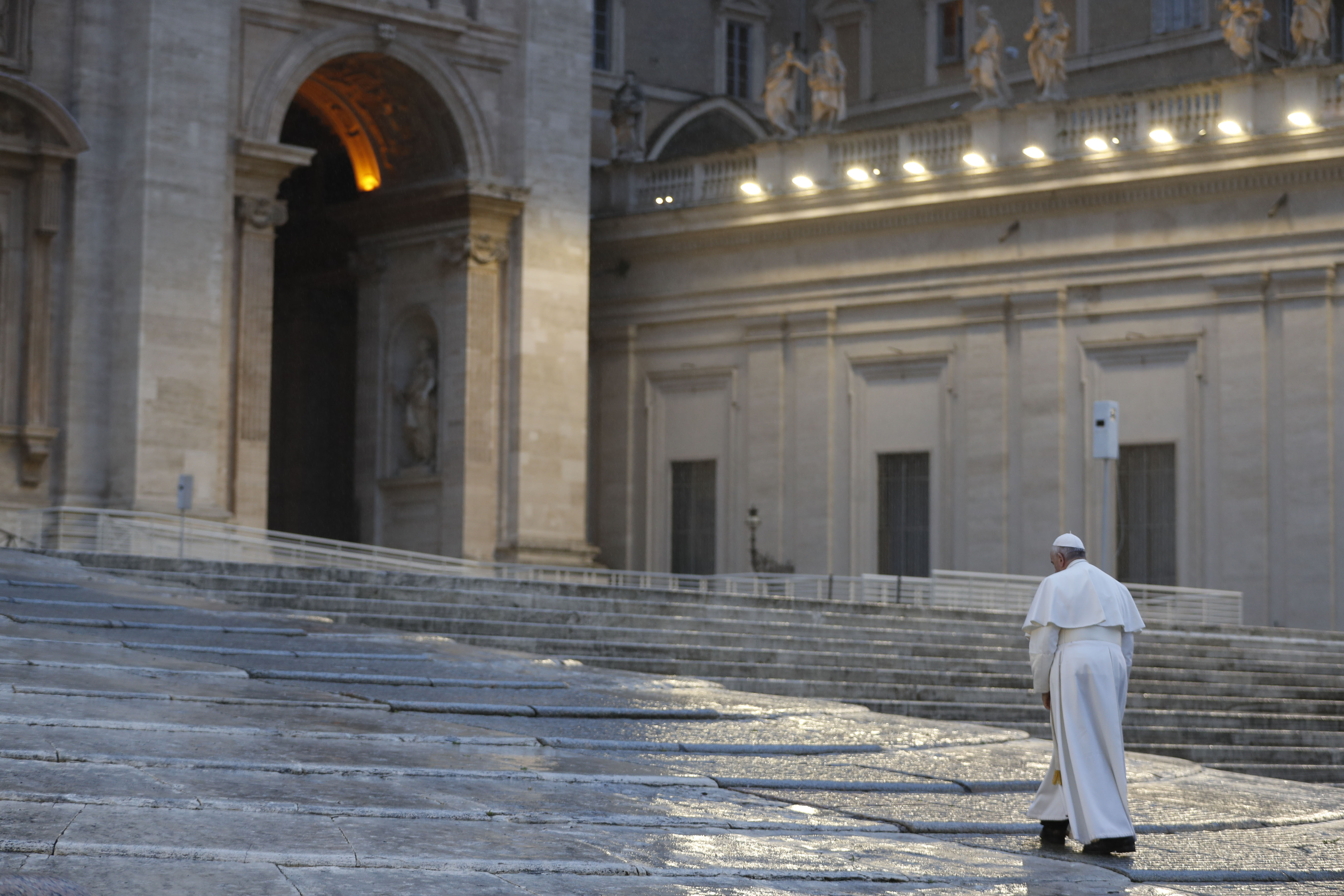 Pope Francis walks towards the platform to preside over a moment of prayer on the sagrato of St Peters Basilica. (Photo by YARA NARDI/POOL/AFP via Getty Images)