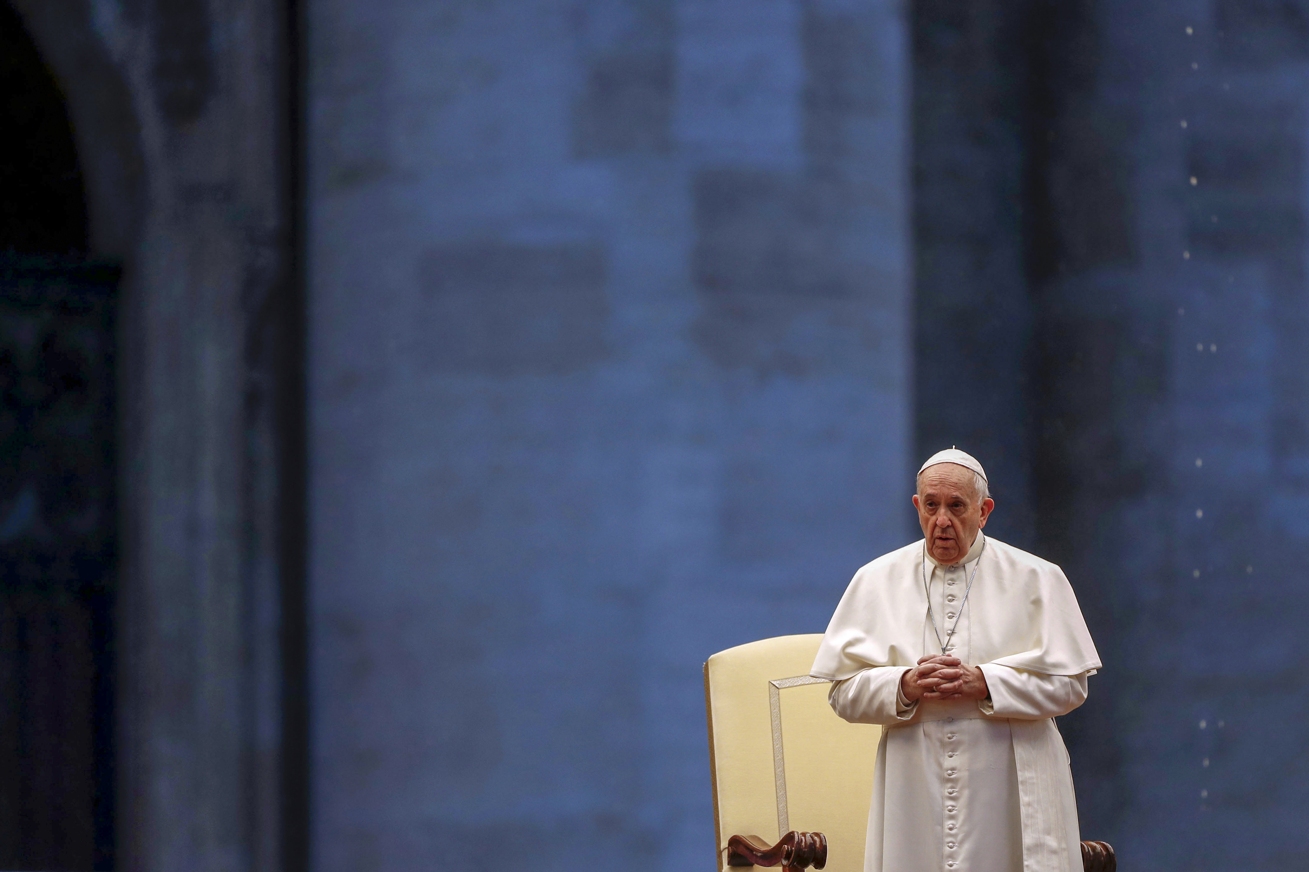 Pope Francis presides over a moment of prayer on the sagrato of St Peters Basilica, the platform at the top of the steps immediately in front of the façade of the Church, to be concluded with the Pope giving the Urbi et Orbi Blessing, on March 27, 2020 at St. Peter's Square in the Vatican. (Photo by YARA NARDI / POOL / AFP) (Photo by YARA NARDI/POOL/AFP via Getty Images)