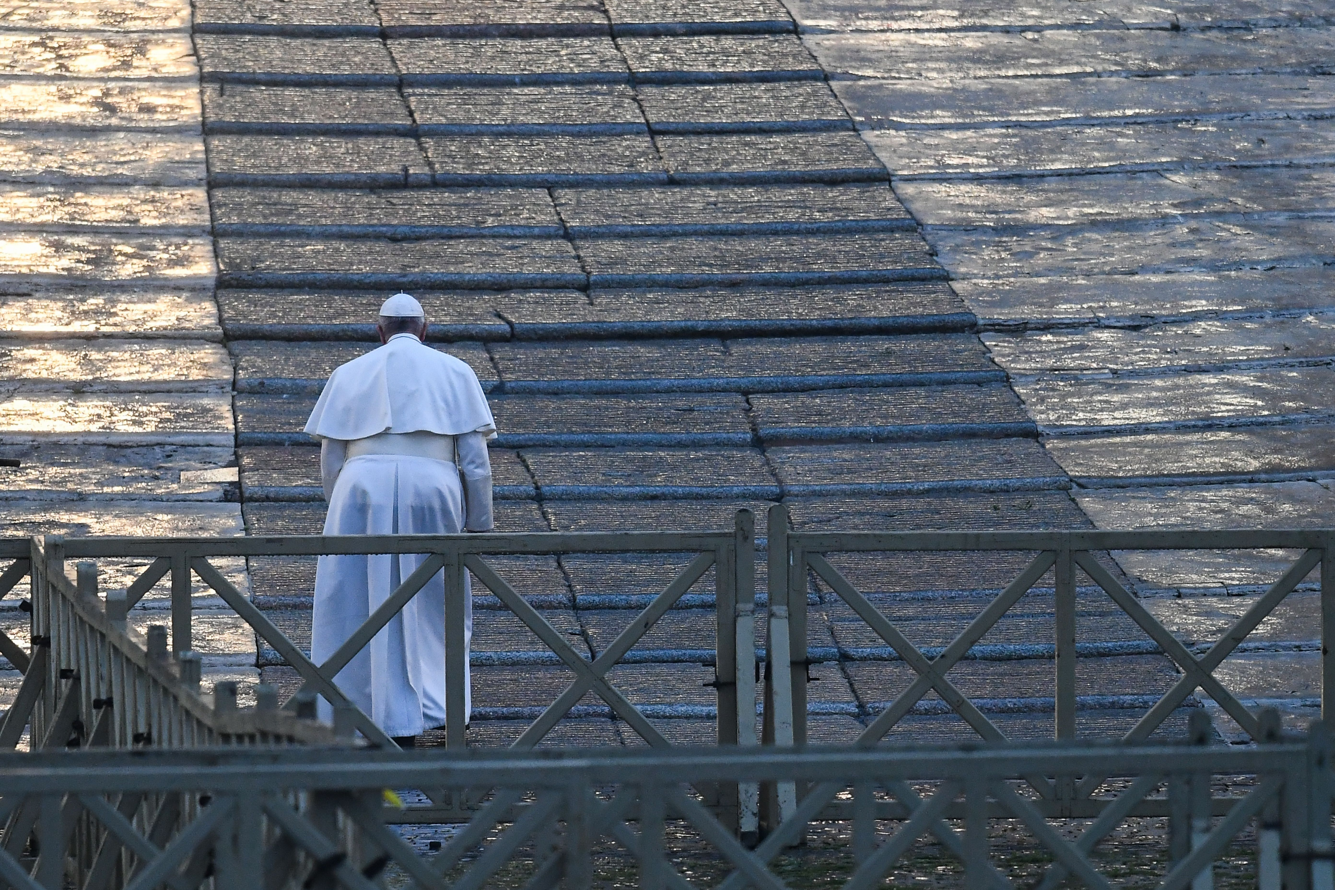 Pope Francis walks towards the platform to preside over a moment of prayer on the sagrato of St Peters Basilica. (Photo by VINCENZO PINTO/AFP via Getty Images)
