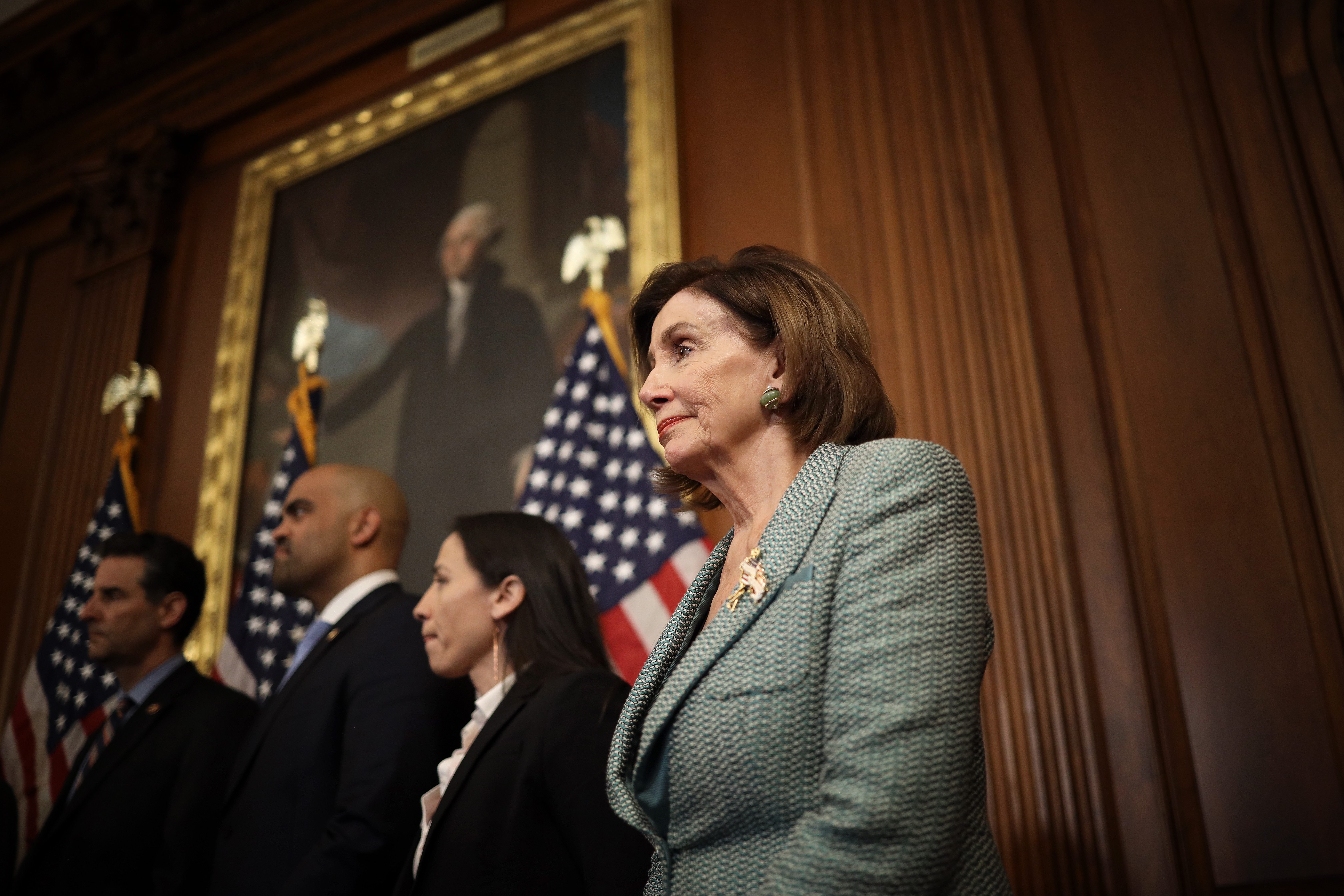 WASHINGTON, DC - MARCH 10: U.S. Speaker of the House Nancy Pelosi (R) (D-CA) attends a press conference marking the one year anniversary of the House passing HR-1, the For The People Act, March 10, 2020 in Washington, DC. After passage by the House of Representatives, Senate Majority Leader Mitch McConnell refused to bring the bill to a vote in the U.S. Senate. (Photo by Win McNamee/Getty Images)