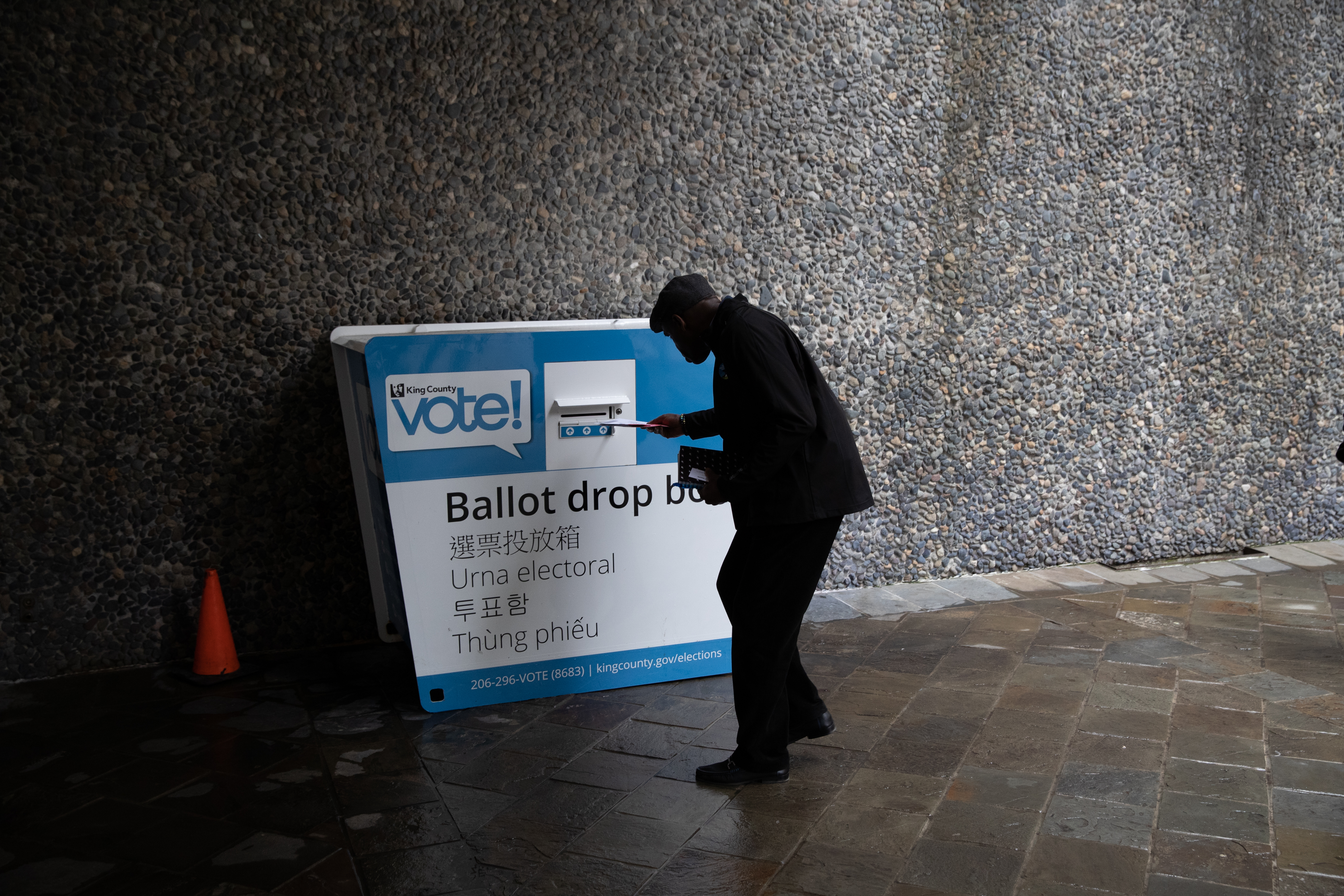 SEATTLE, WASHINGTON - MARCH 10: A voter casts his ballot during primary elections on March 10, 2020 in Seattle, Washington. Although most Washington State ballots are mailed-in, many people deposit their votes in ballot drop boxes throughout the state. (Photo by John Moore/Getty Images)