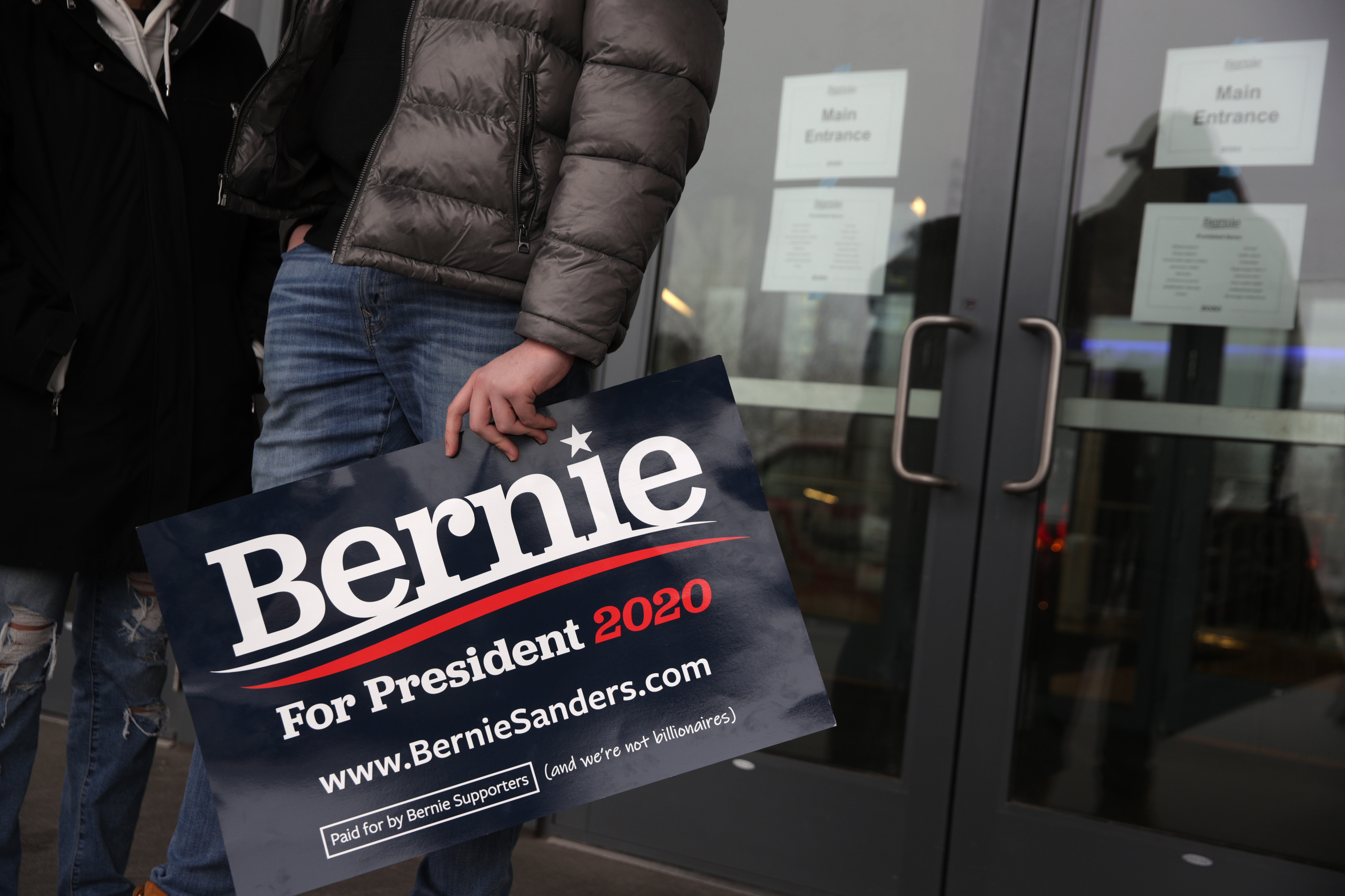 A supporter holds a campaign sign as he waits at the entrance after a campaign rally of Democratic presidential candidate Sen. Bernie Sanders (I-VT) has been cancelled at the Huntington Convention Center March 10, 2020 in Cleveland, Ohio. (Alex Wong/Getty Images)