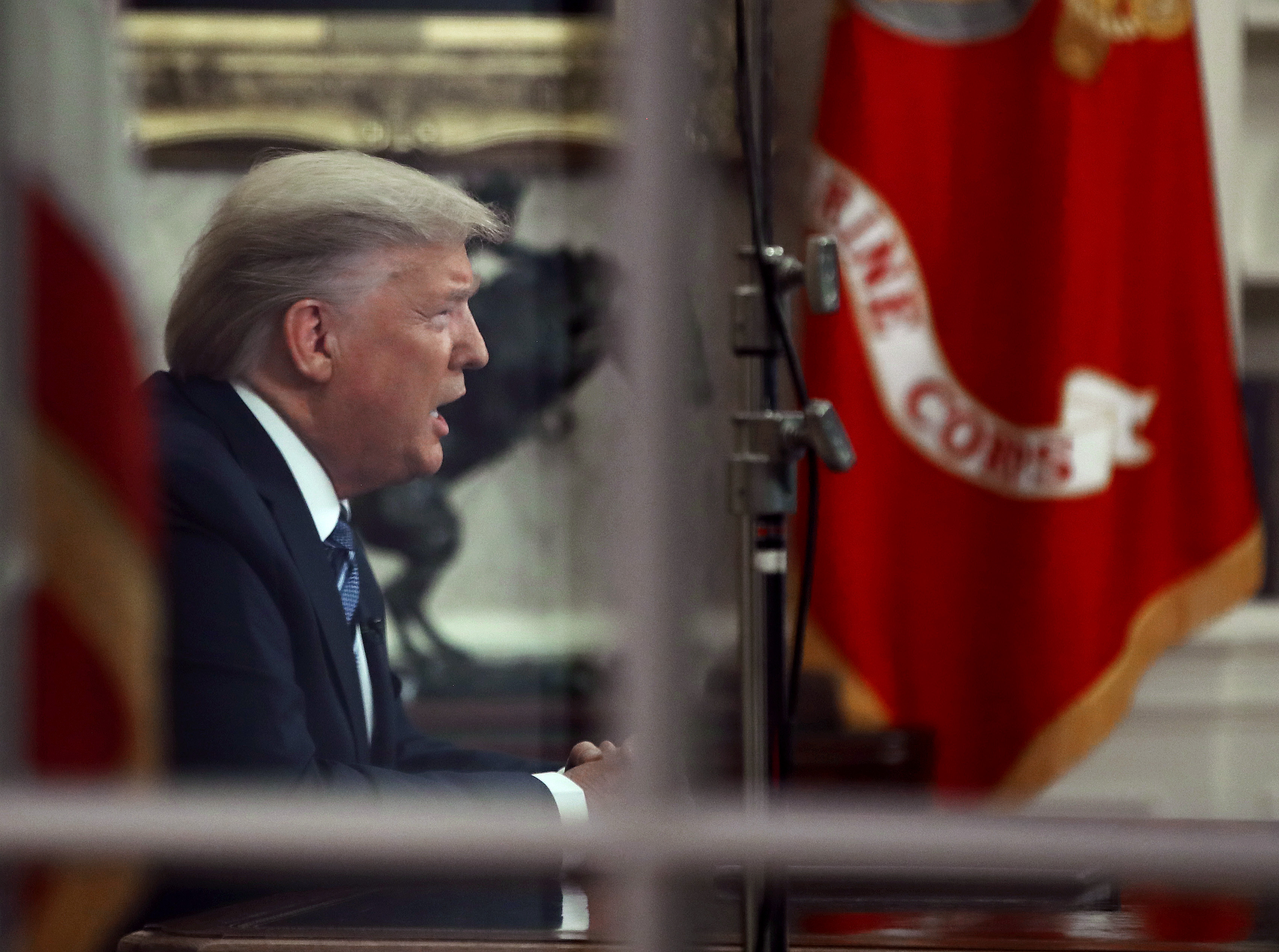 WASHINGTON, DC - MARCH 11: U.S. President Donald Trump is seen through a window in the Oval Office as he addresses the nation on the response to the COVID-19 coronavirus, on March 11, 2020 in Washington, DC. (Photo by Mark Wilson/Getty Images)