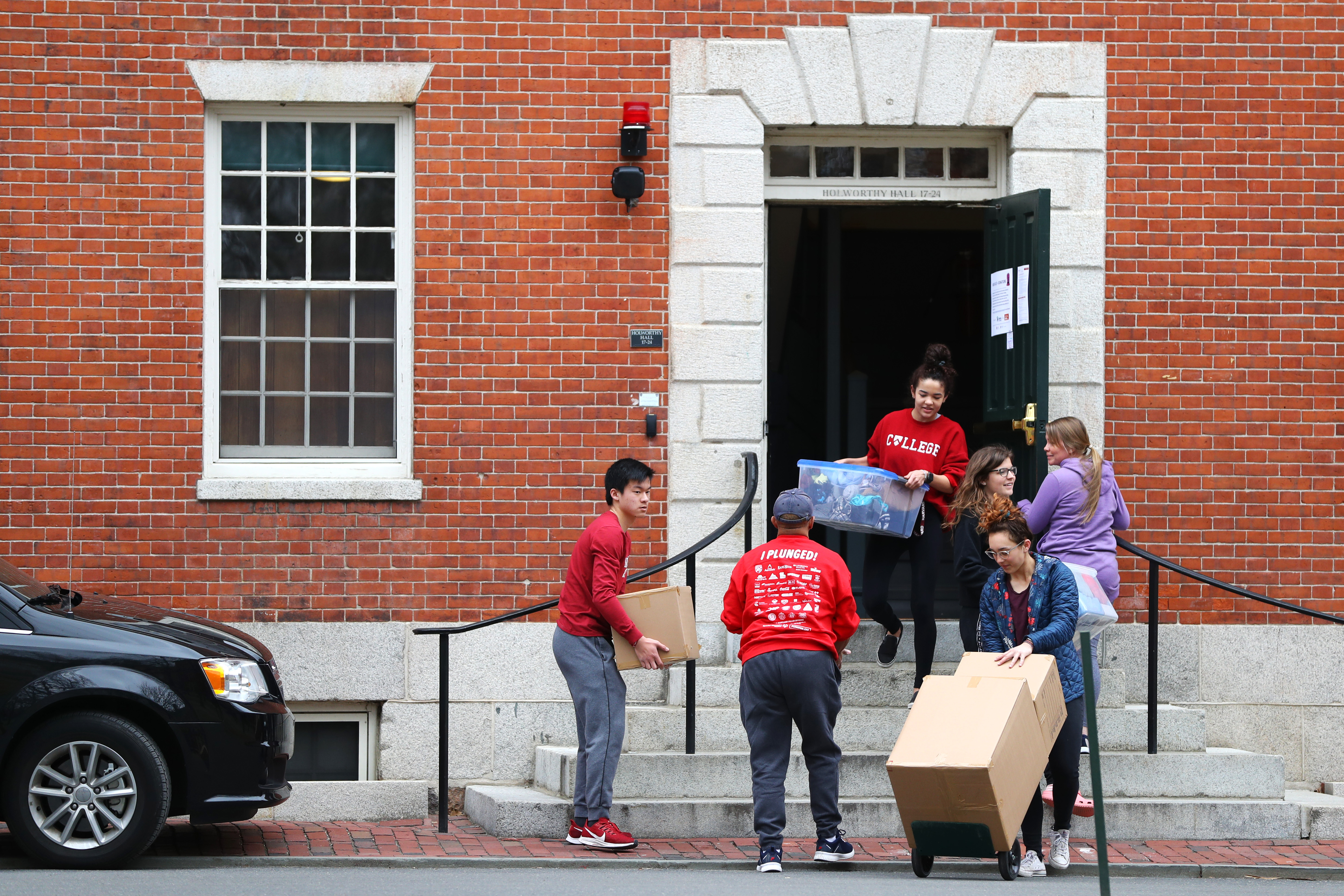 CAMBRIDGE, MASSACHUSETTS - MARCH 12: Students move out of dorm rooms on Harvard Yard on the campus of Harvard University on March 12, 2020 in Cambridge, Massachusetts. Students have been asked to move out of their dorms by March 15 due to the Coronavirus (COVID-19) risk. (Photo by Maddie Meyer/Getty Images)