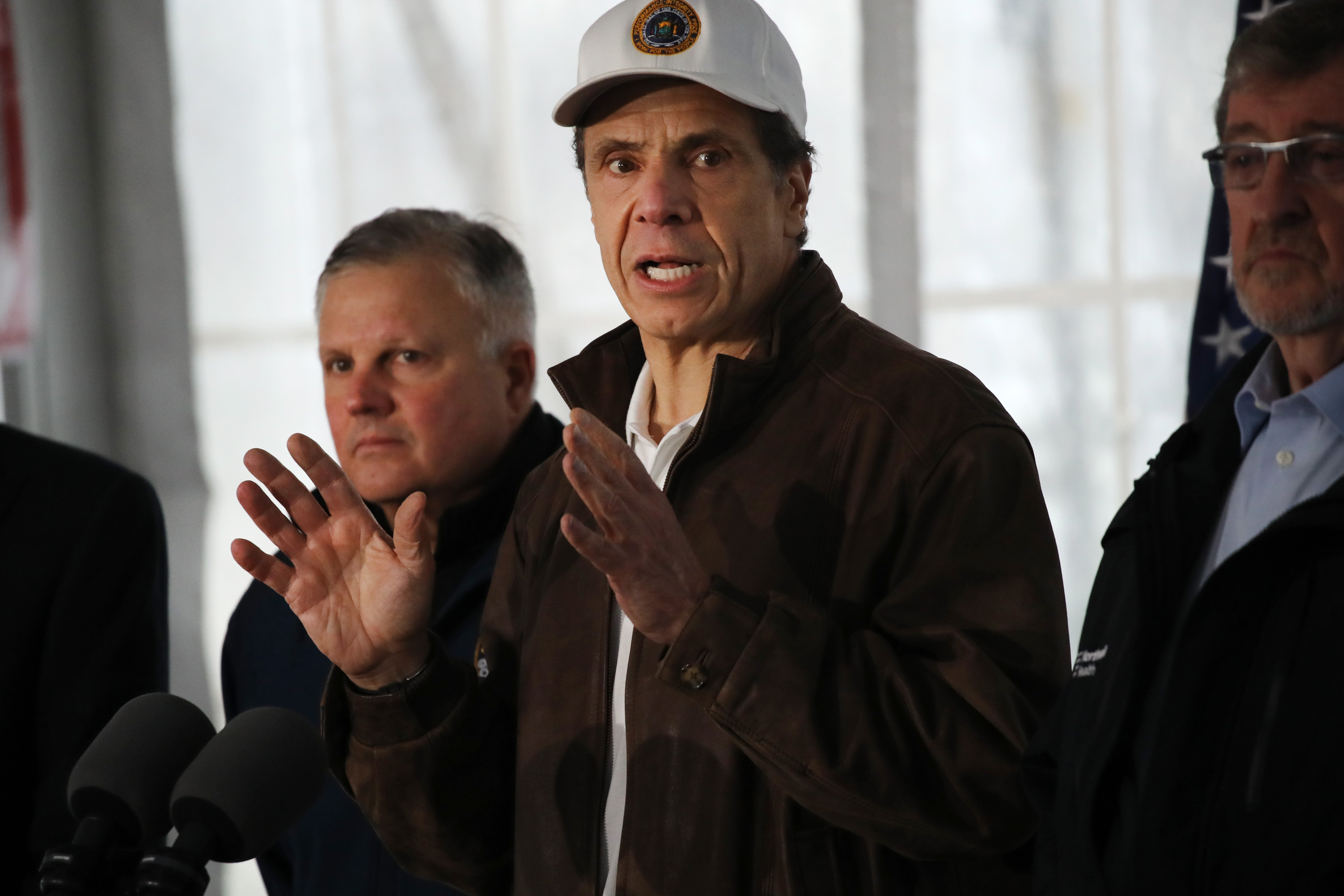 "NEW ROCHELLE, NEW YORK - MARCH 13: New York Governor Andrew Cuomo speaks to the media and tours a newly opened drive through COVID-19 mobile testing center on March 13, 2020 in New Rochelle, New York. The center serves all parts of Westchester County and will test up to 200 people today, growing to up to 500 people per day in the coming days. New Rochelle, a city just north of New York City, has become the state's largest source of coronavirus infections, prompting Governor Andrew Cuomo to implement the one mile radius ""containment area"" as the nation sees a daily increase in the number of virus cases. (Photo by Spencer Platt/Getty Images)"