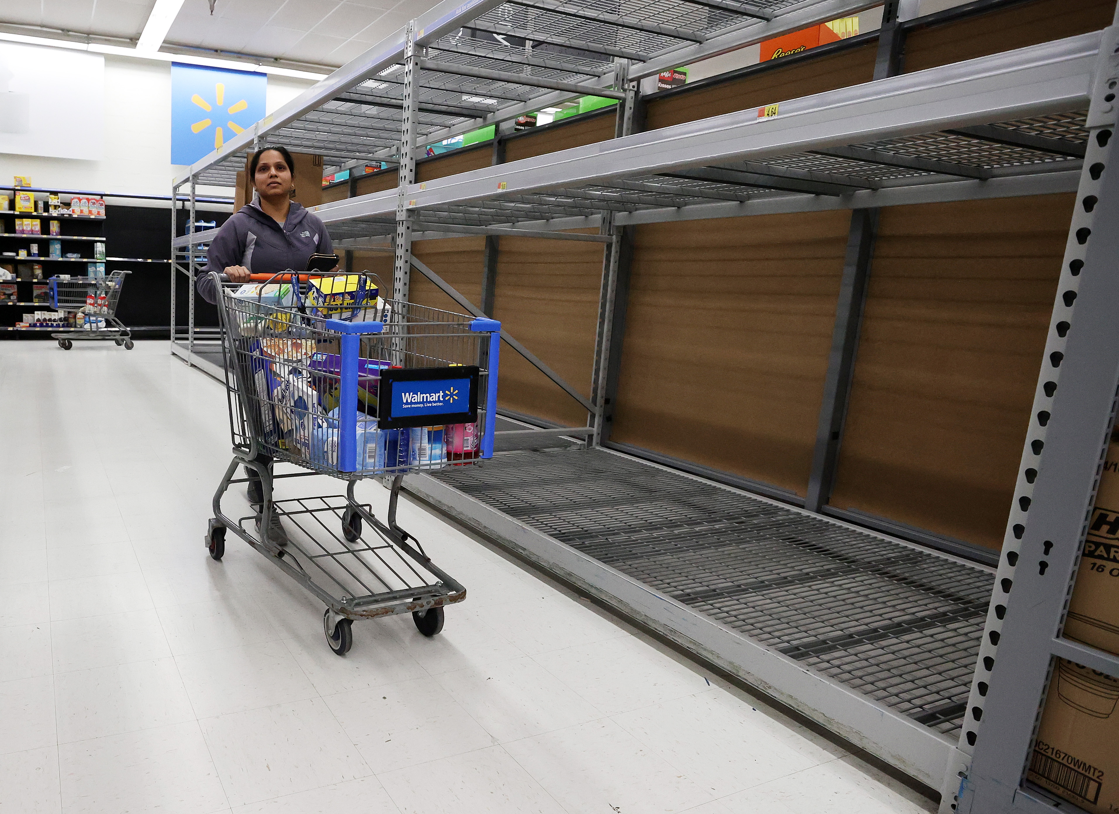 UNIONDALE, NEW YORK, - MARCH 14: As the coronavirus continues to spread across the United States, stores like Walmart had problems keeping up with the high demand for paper goods leading to empty shelves. (Photo by Al Bello/Getty Images)