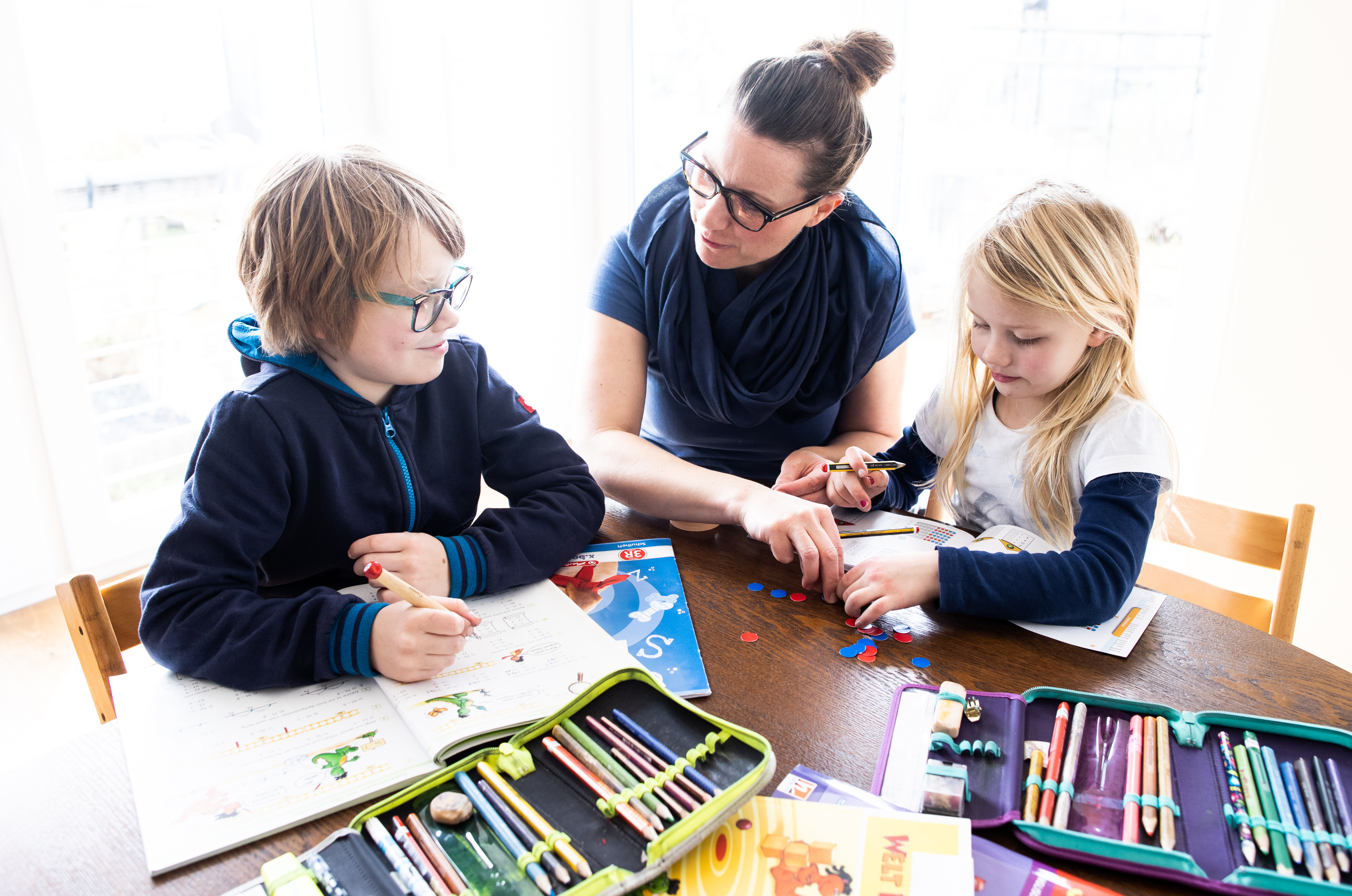 DINSLAKEN, GERMANY - MARCH 15: A mother helps her nine-year-old son and six-year-old daughter to do school homework on March 15, 2020 in Dinslaken, Germany. (Photo by Lars Baron/Getty Images)