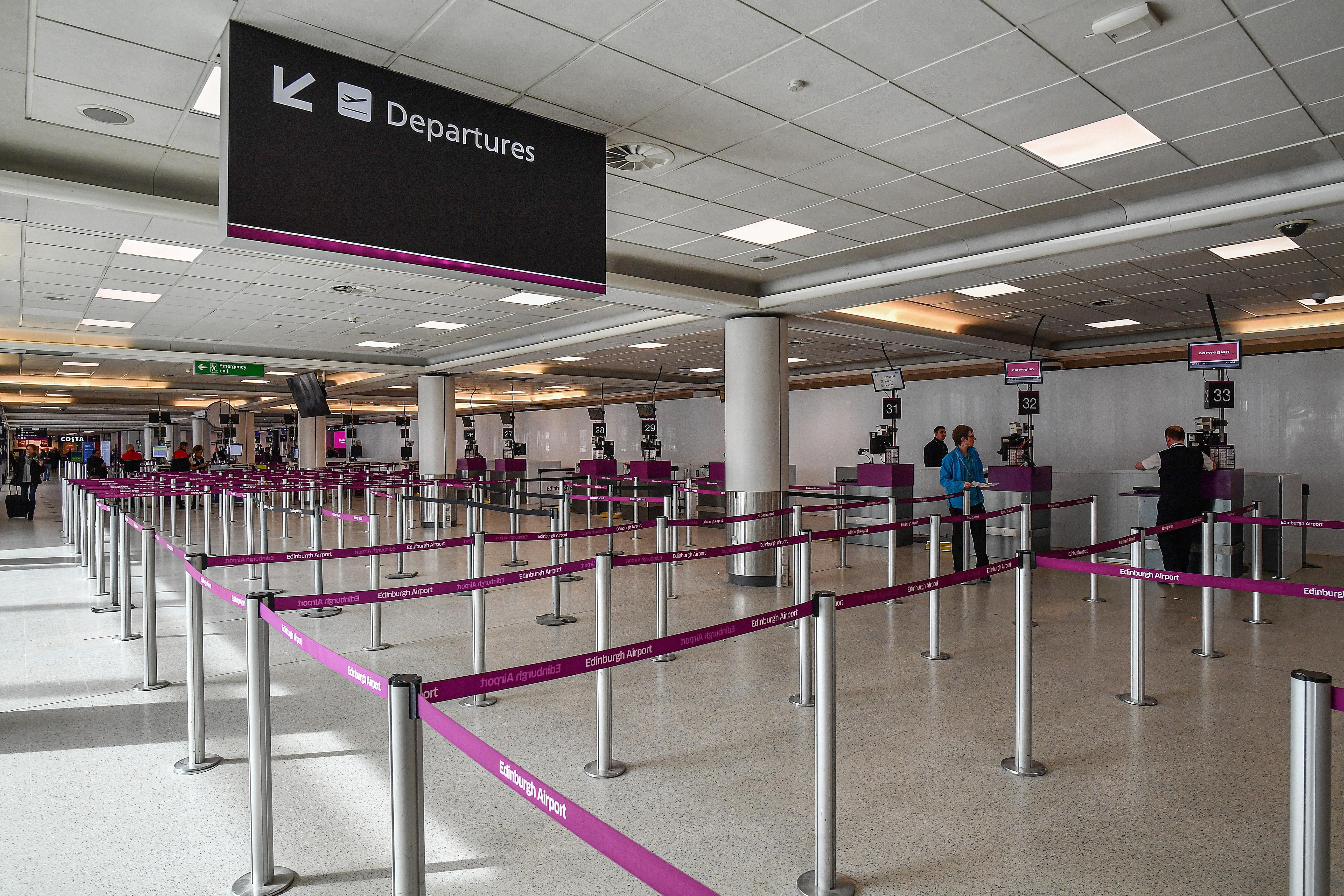 Passengers wait for flights at Edinburgh Airport on March 16, 2020 in Edinburgh,Scotland. (Jeff J Mitchell/Getty Images)