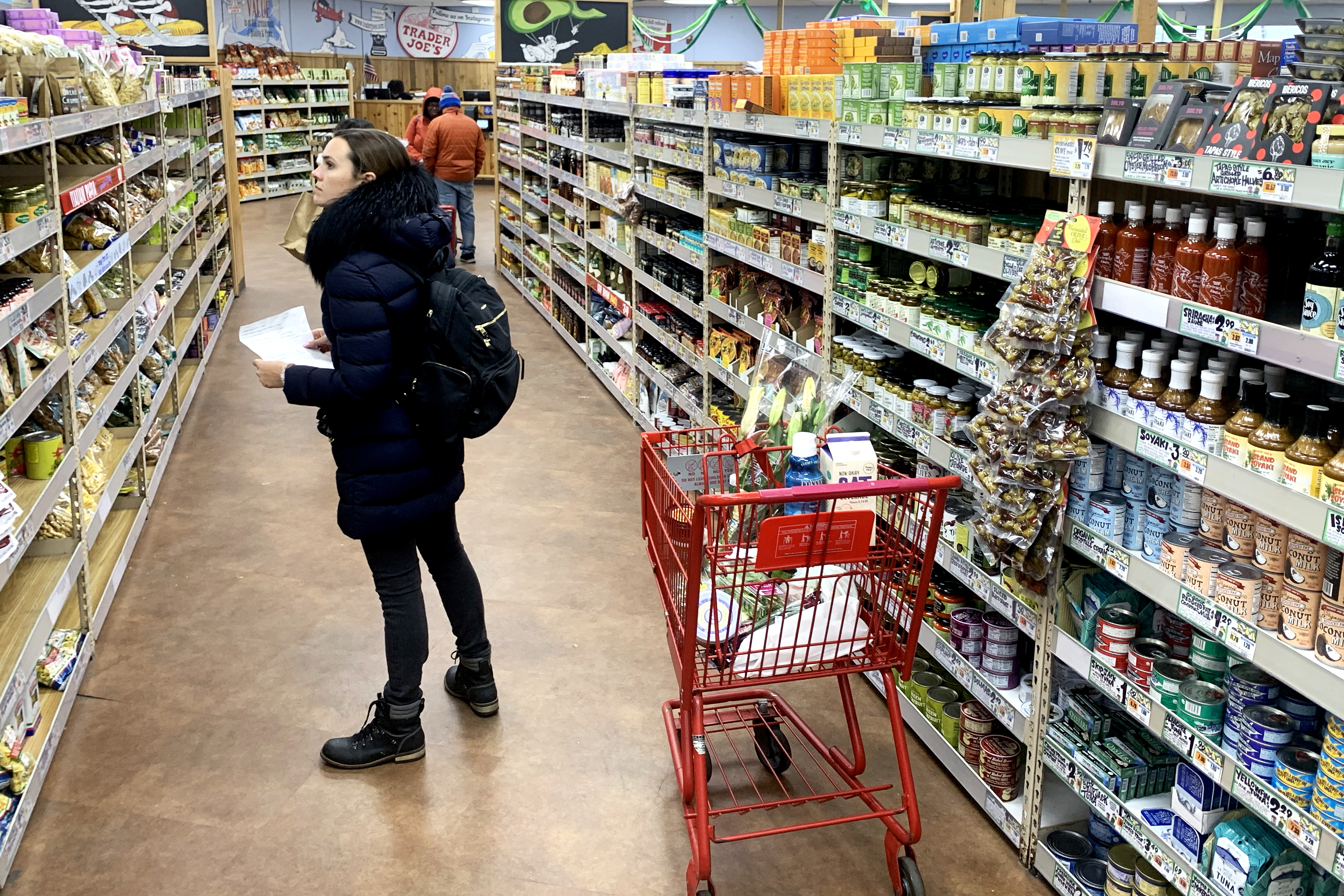 CAMBRIDGE, MASSACHUSETTS - MARCH 23: A woman shops at Trader Joe's at on March 23, 2020 in Cambridge, Massachusetts. The store has begun limiting the capacity of shoppers allowed inside, and offering sanitizing wipes upon entry. (Photo by Maddie Meyer/Getty Images)