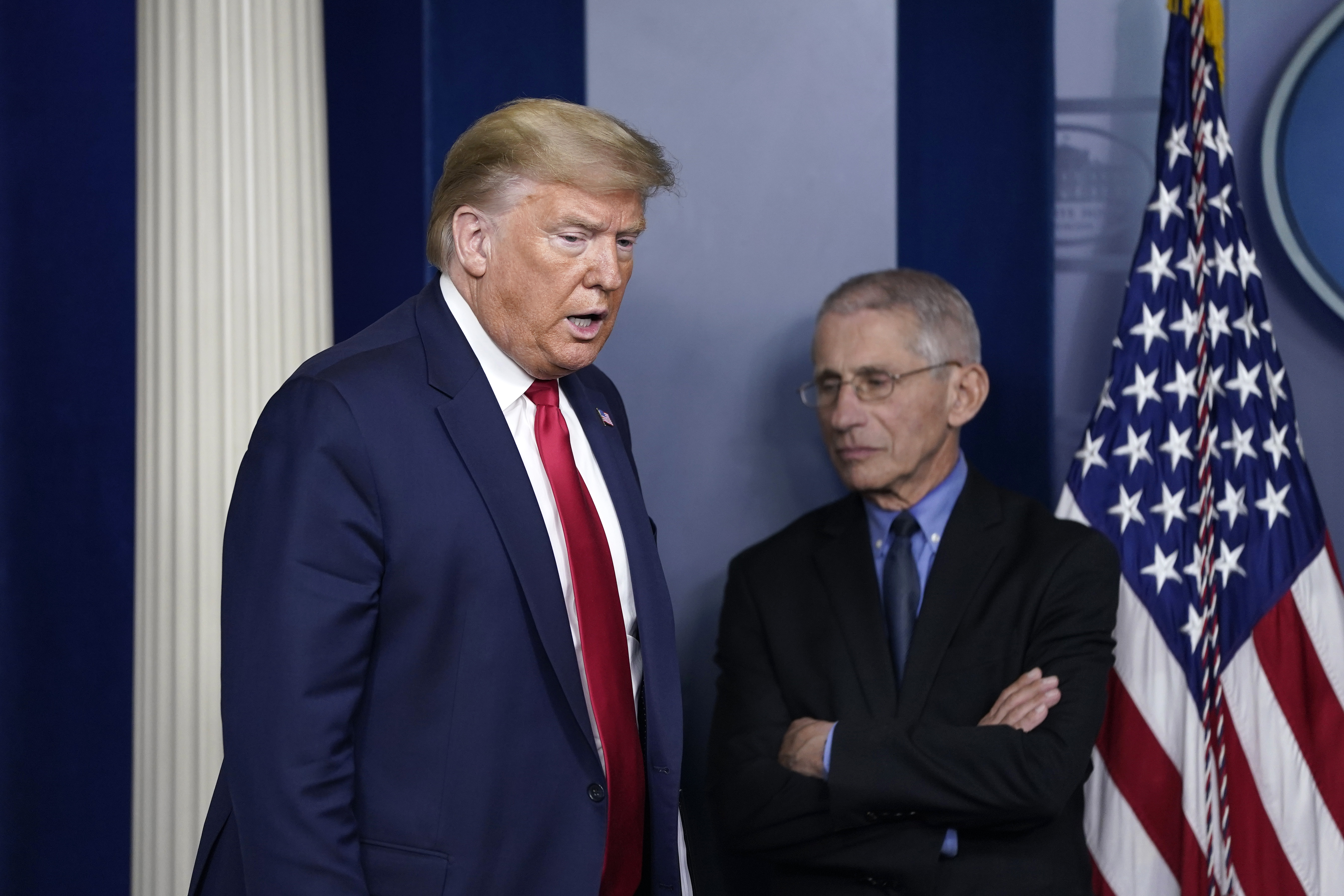 President Donald Trump arrives as National Institute of Allergy and Infectious Diseases Director Anthony Fauci waits for the beginning of a briefing on the coronavirus pandemic in the press briefing room of the White House on March 26, 2020 in Washington, DC. The U.S. House of Representatives is scheduled to vote Friday on the $2 trillion stimulus package to combat the effects of the COVID-19 pandemic. (Photo by Drew Angerer/Getty Images)