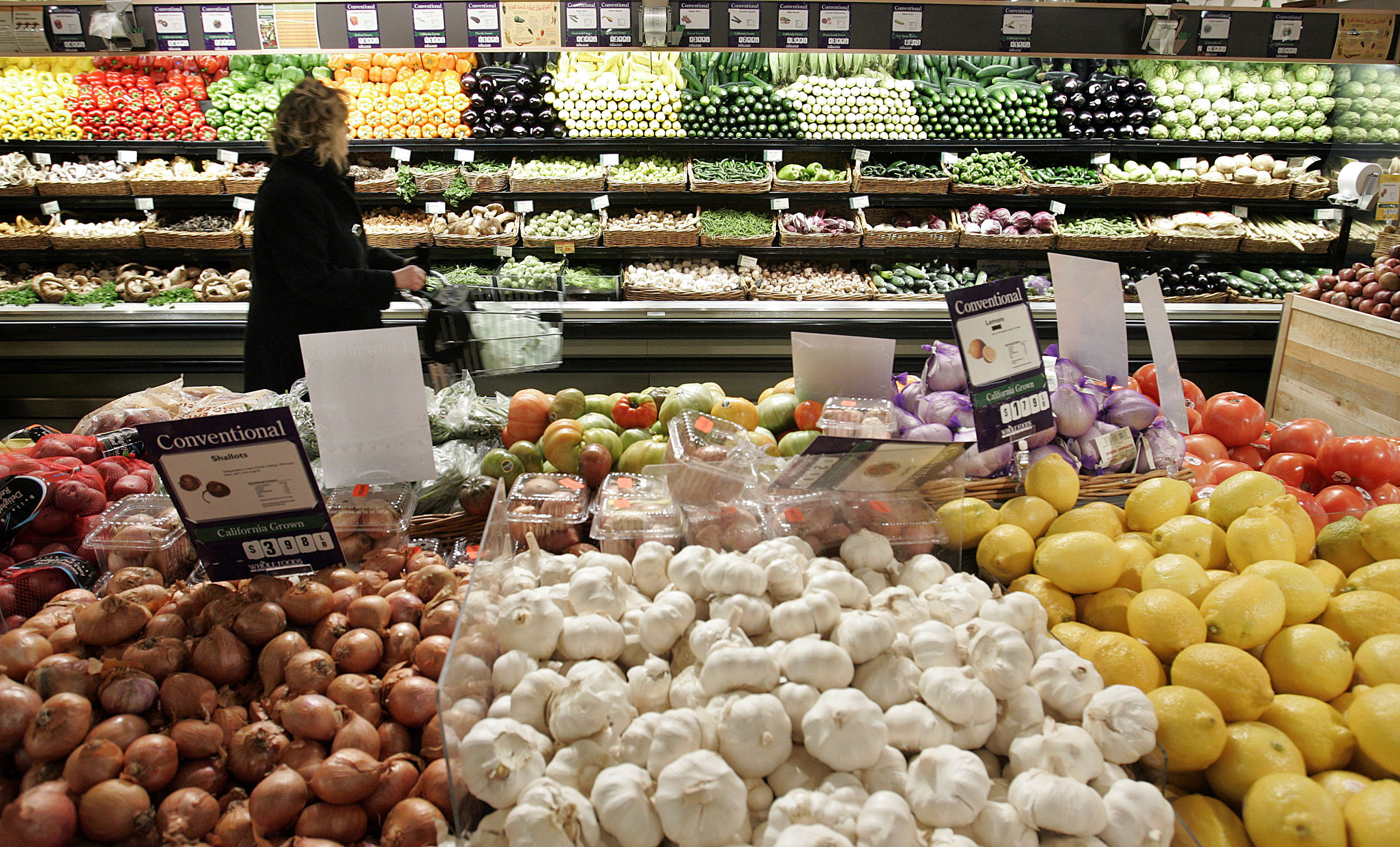 NEW YORK - JANUARY 13: A woman shops in the produce section at Whole Foods (Photo by Stephen Chernin/Getty Images)