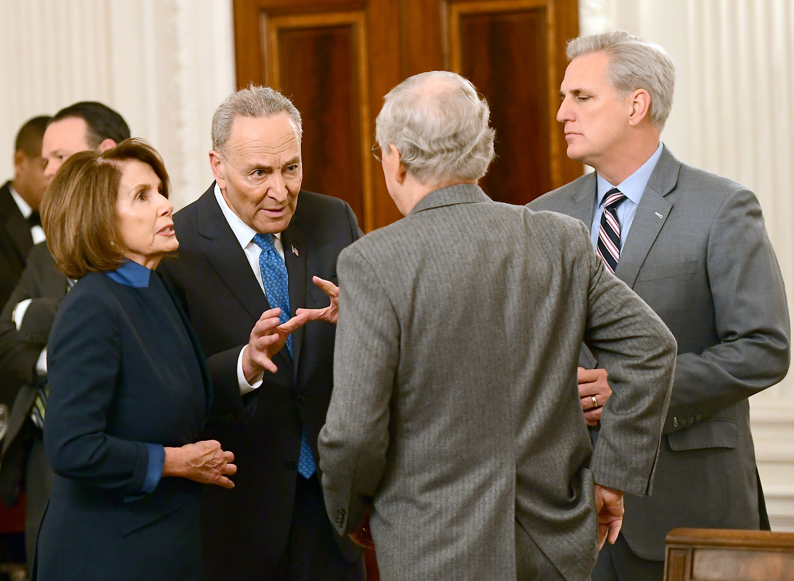 WASHINGTON, DC - JANUARY 23: (L-R) U.S. House Minority Leader Nancy Pelosi (D-CA), Senate Minority Leader Chuck Schumer (D-NY), Senate Minority Leader Mitch McConnell (R-KY) and House Majority Leader Kevin McCarthy (R-CA) talk at a reception held by President Donald Trump for House and Senate Republican and Democratic leaders in the State Dining Room of the White House January 23, 2017 in Washington, DC. (Photo by Ron Sachs-Pool/Getty Images)