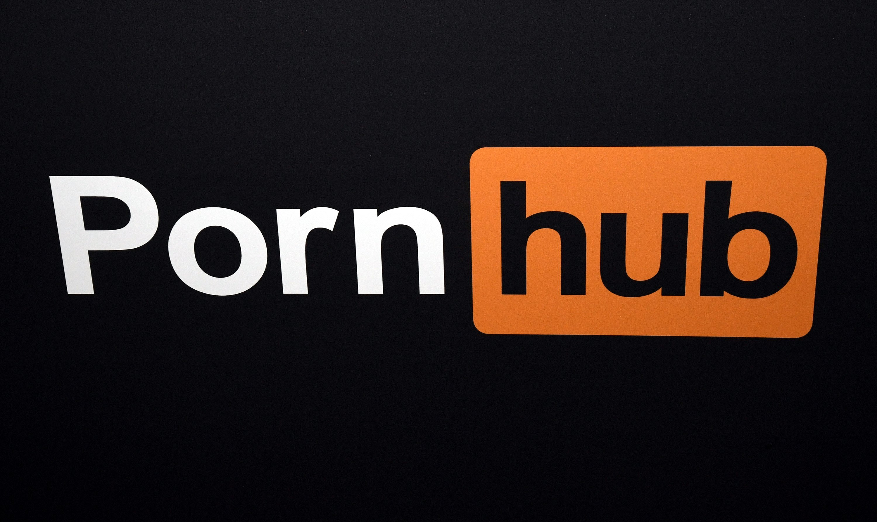 Pornhub logo is displayed at the company's booth at the 2018 AVN Adult Entertainment Expo at the Hard Rock Hotel & Casino on January 24, 2018 in Las Vegas, Nevada. (Photo by Ethan Miller/Getty Images)