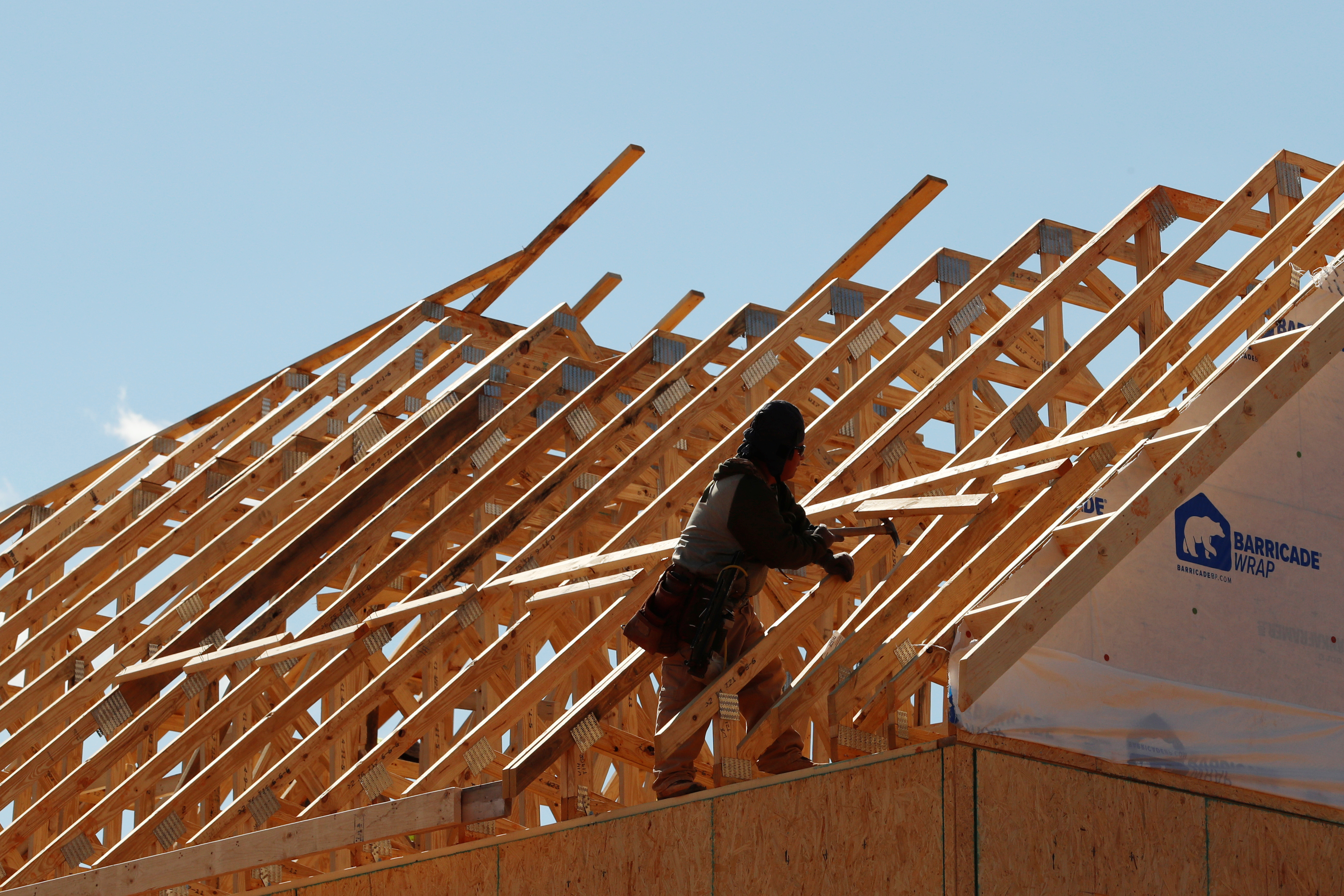 Workers prepare a roof at an under construction home in a new development in York County, South Carolina
