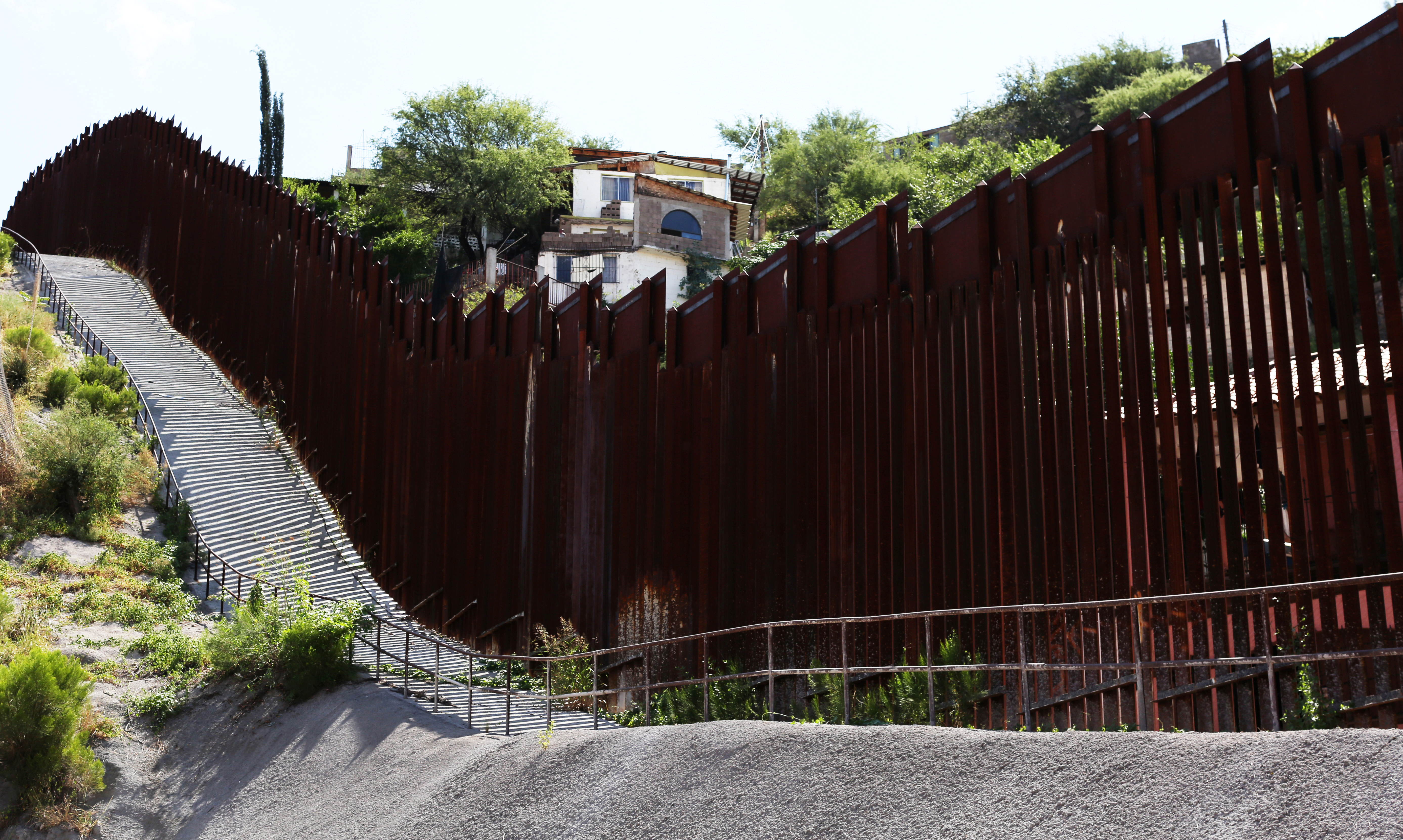 The U.S.-Mexico border fence cuts through Nogales