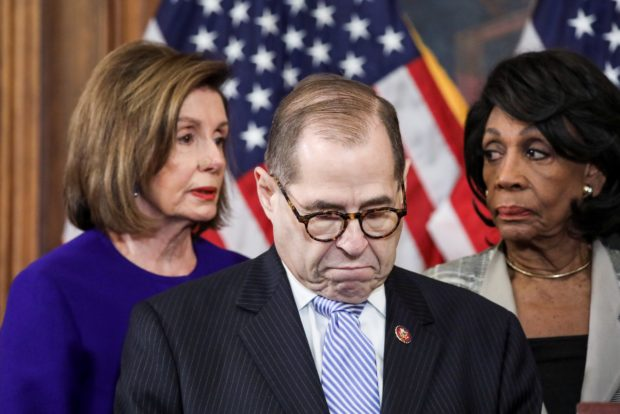House Judiciary Chairman Jerrold Nadler (D-NY) stands with U.S. House Speaker Nancy Pelosi (D-CA), House Financial Services Chairwoman Maxine Waters (D-CA) and other House committee chairs at a news conference to announce articles of impeachment against U.S. President Donald Trump on Capitol Hill in Washington, U.S., Dec. 10, 2019. REUTERS/Jonathan Ernst