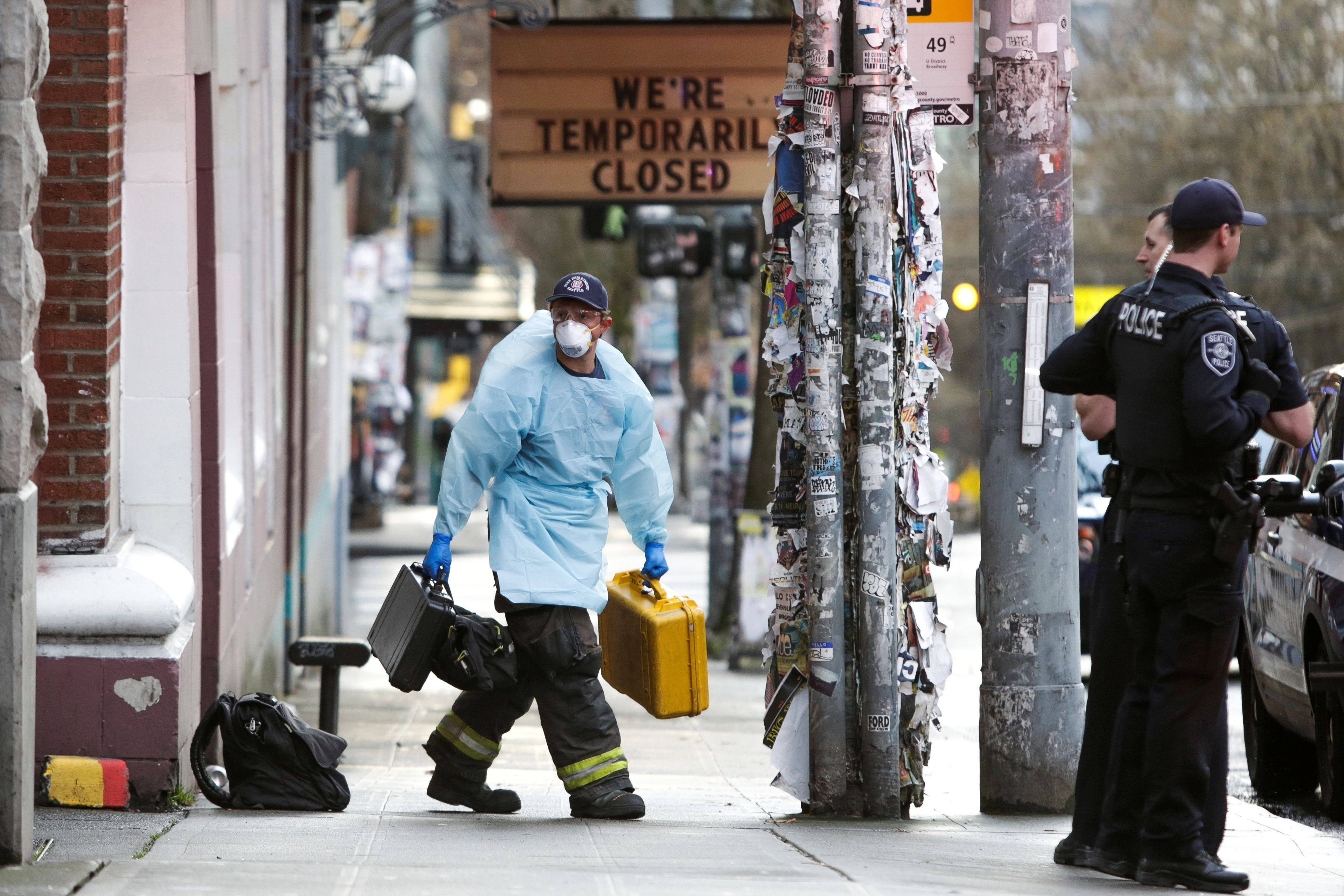 A member of the Seattle Fire Department wears personal protective equipment (PPE) following a medical response as efforts continue to help slow the spread of coronavirus disease (COVID-19) in Seattle, Washington, U.S. March 31, 2020. REUTERS/Jason Redmond