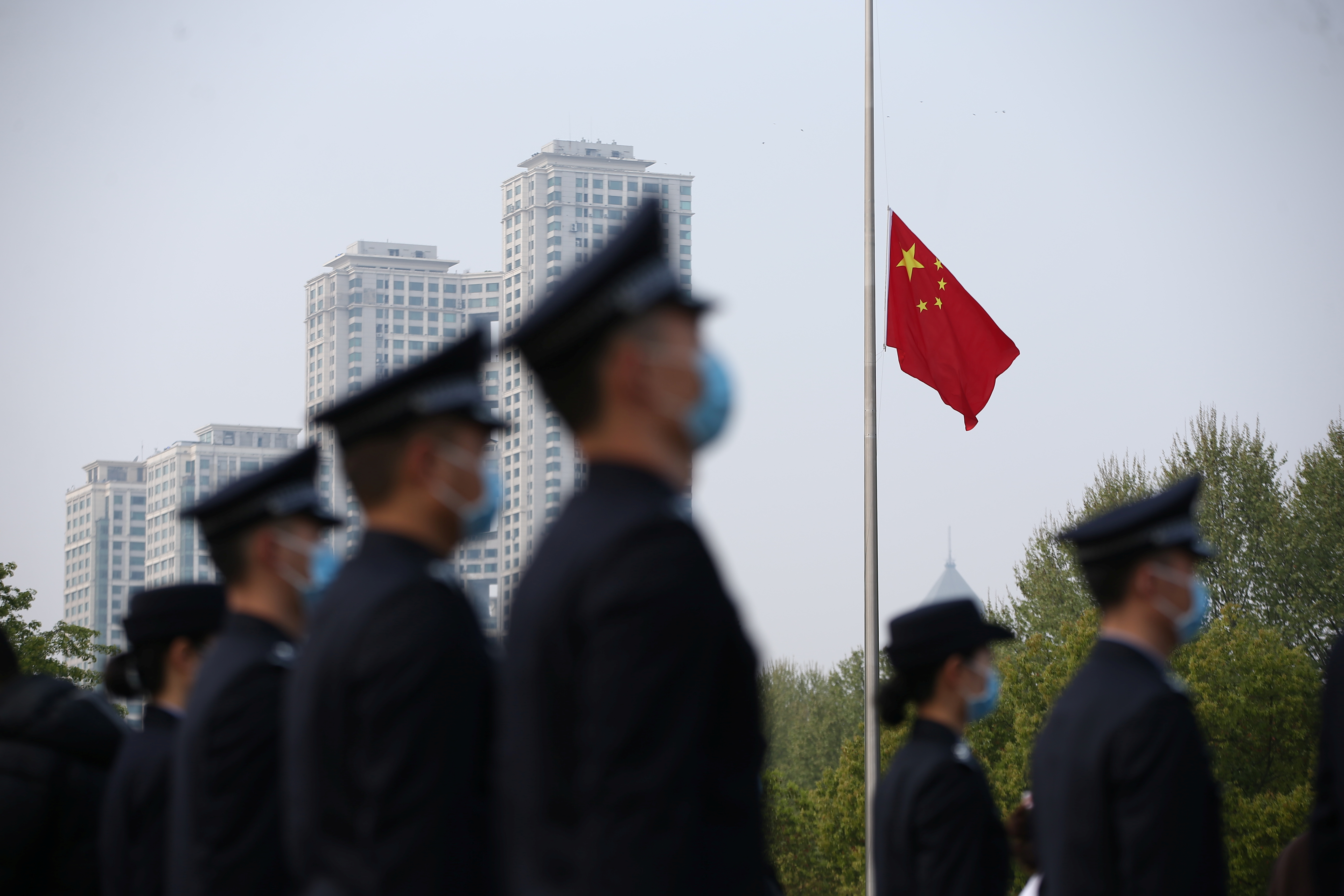 The Chinese national flag flies at half mast at a ceremony mourning those who died of the coronavirus disease (COVID-19) as China holds a nationwide mourning on the Qingming tomb-sweeping festival, in Wuhan, Hubei province, China Apr. 4, 2020. China Daily via REUTERS