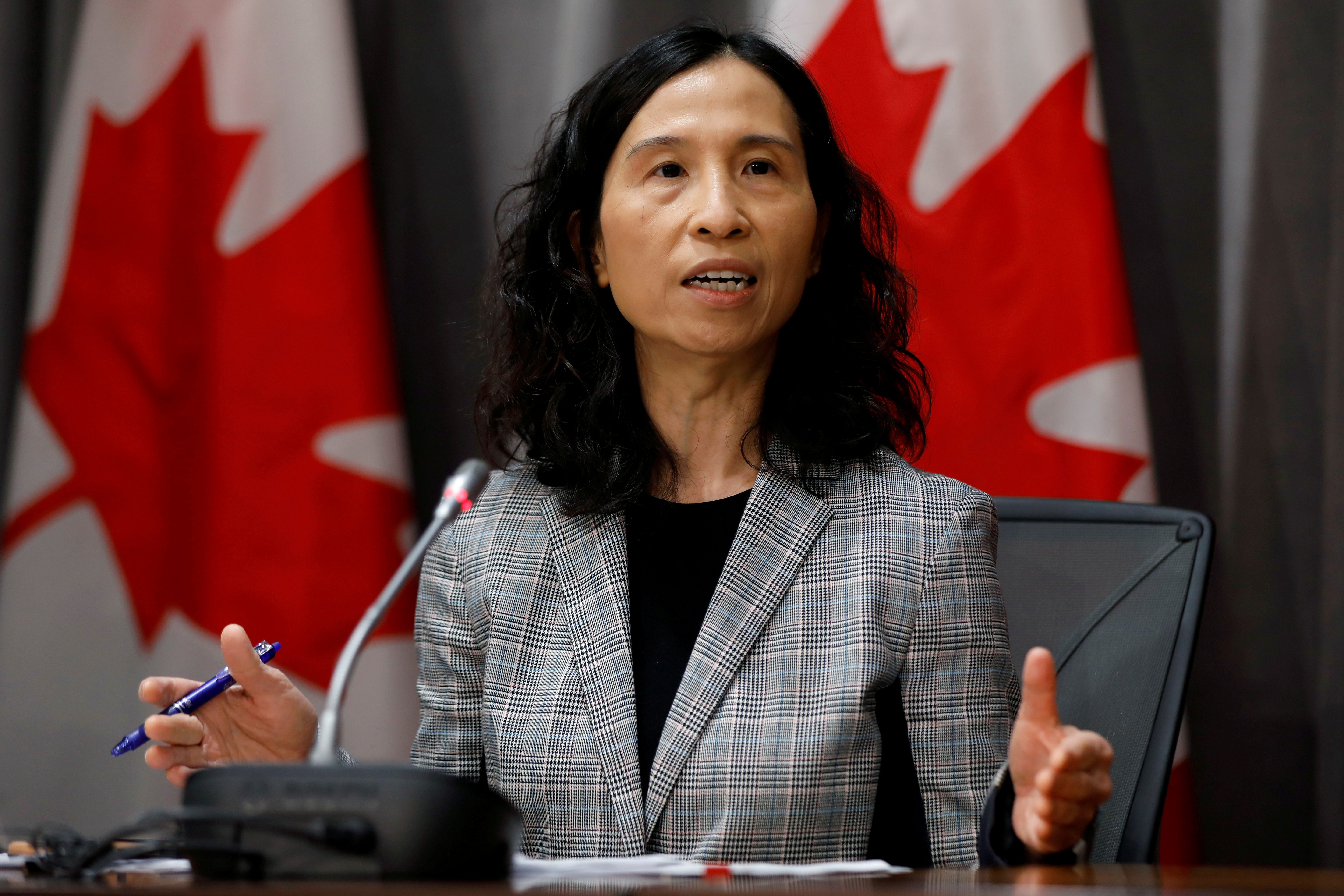 FILE PHOTO: Canada's Chief Public Health Officer Dr. Theresa Tam attends a news conference as efforts continue to help slow the spread of coronavirus disease (COVID-19) in Ottawa, Ontario, Canada March 23, 2020. REUTERS/Blair Gable/File Photo