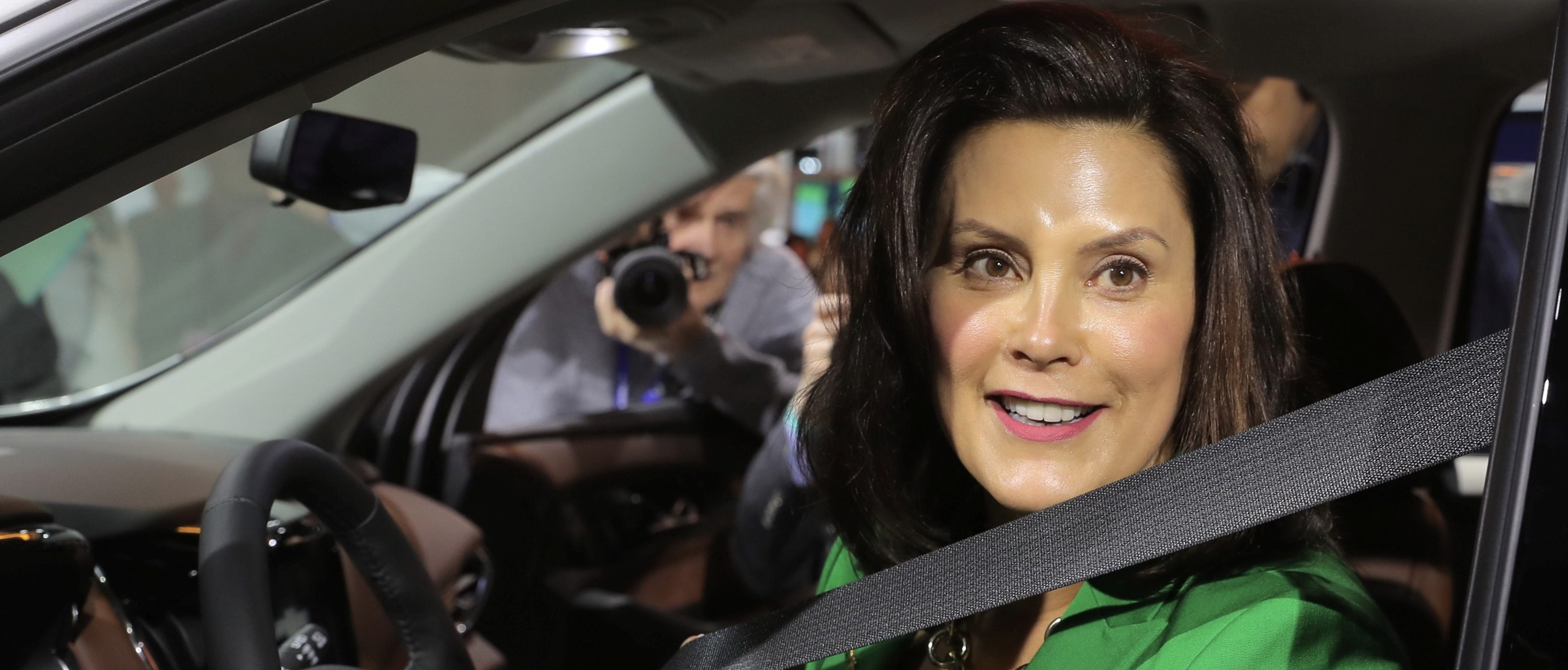 FILE PHOTO: Michigan Governor Gretchen Whitmer sits in a 2019 Chevrolet Traverse, assembled in Lansing, Michigan, at the General Motors display area during the North American International Auto Show in Detroit, Michigan, U.S., Jan. 15, 2019. REUTERS/Rebecca Cook/File Photo
