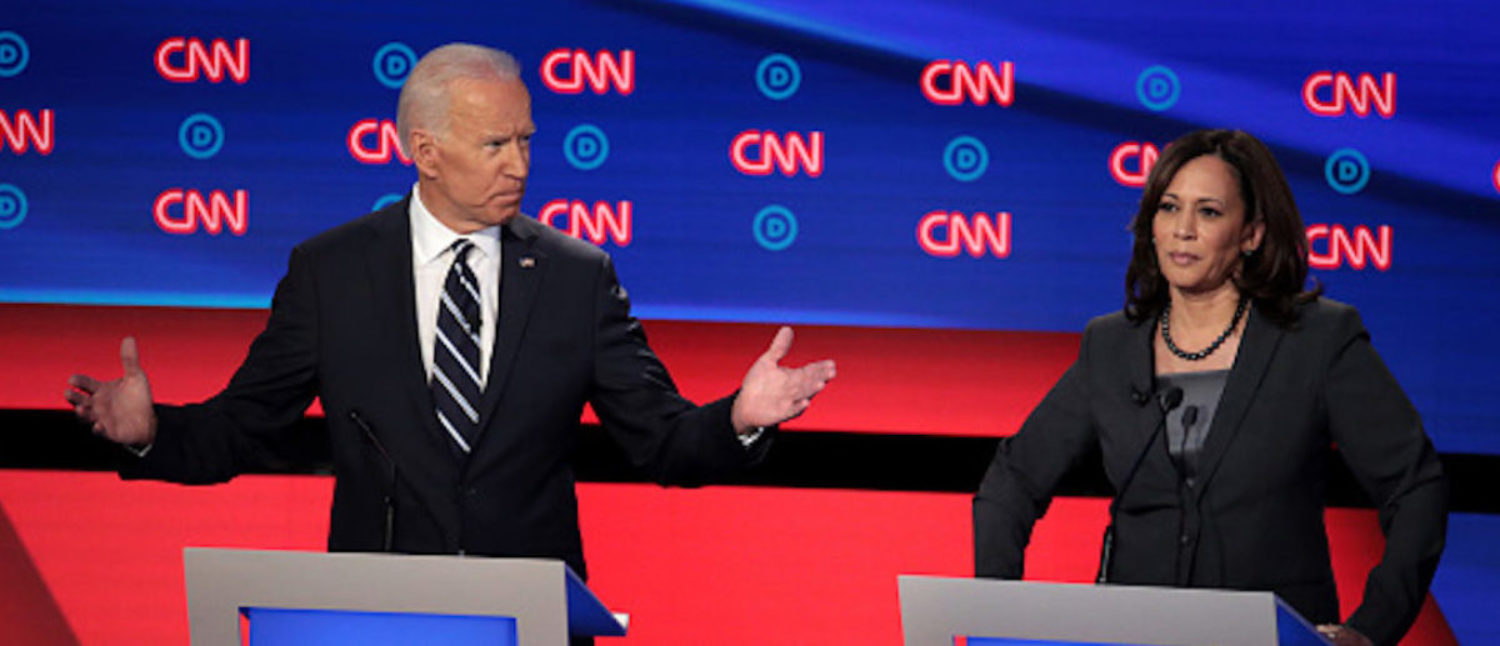 DETROIT, MICHIGAN - JULY 31: Democratic presidential candidate former Vice President Joe Biden (L) speaks while Sen. Kamala Harris (D-CA) listens during the Democratic Presidential Debate at the Fox Theatre July 31, 2019 in Detroit, Michigan. 20 Democratic presidential candidates were split into two groups of 10 to take part in the debate sponsored by CNN held over two nights at Detroit?s Fox Theatre. (Photo by Scott Olson/Getty Images)