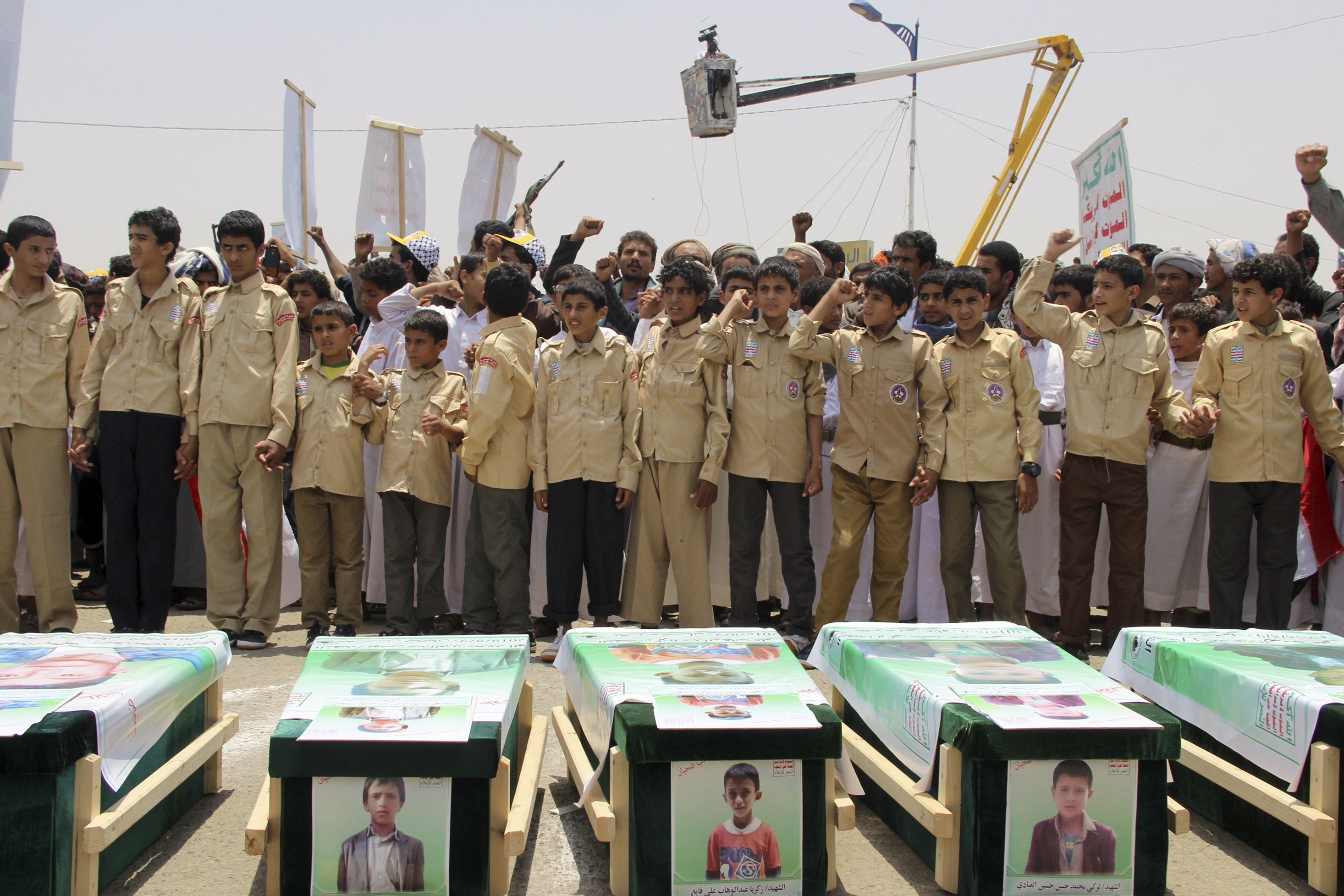 Yemeni children vent anger against Riyadh and Washington on August 13, 2018 as they take part in a mass funeral. (STRINGER/AFP via Getty Images)