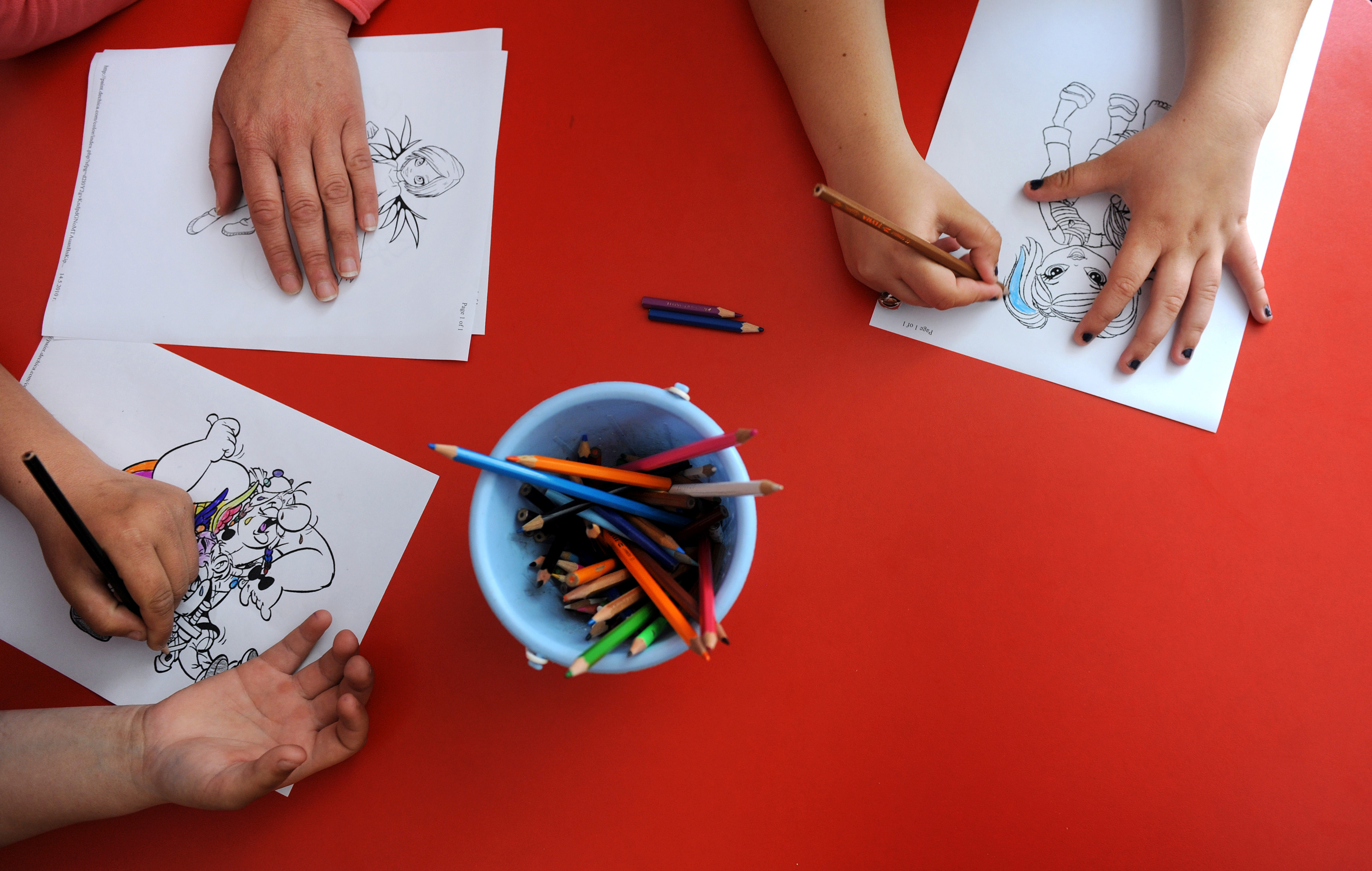 This picture taken on May 14, 2010, shows children colouring a pattern in a Daycare centre. (NIKOLAY DOYCHINOV/AFP via Getty Images)