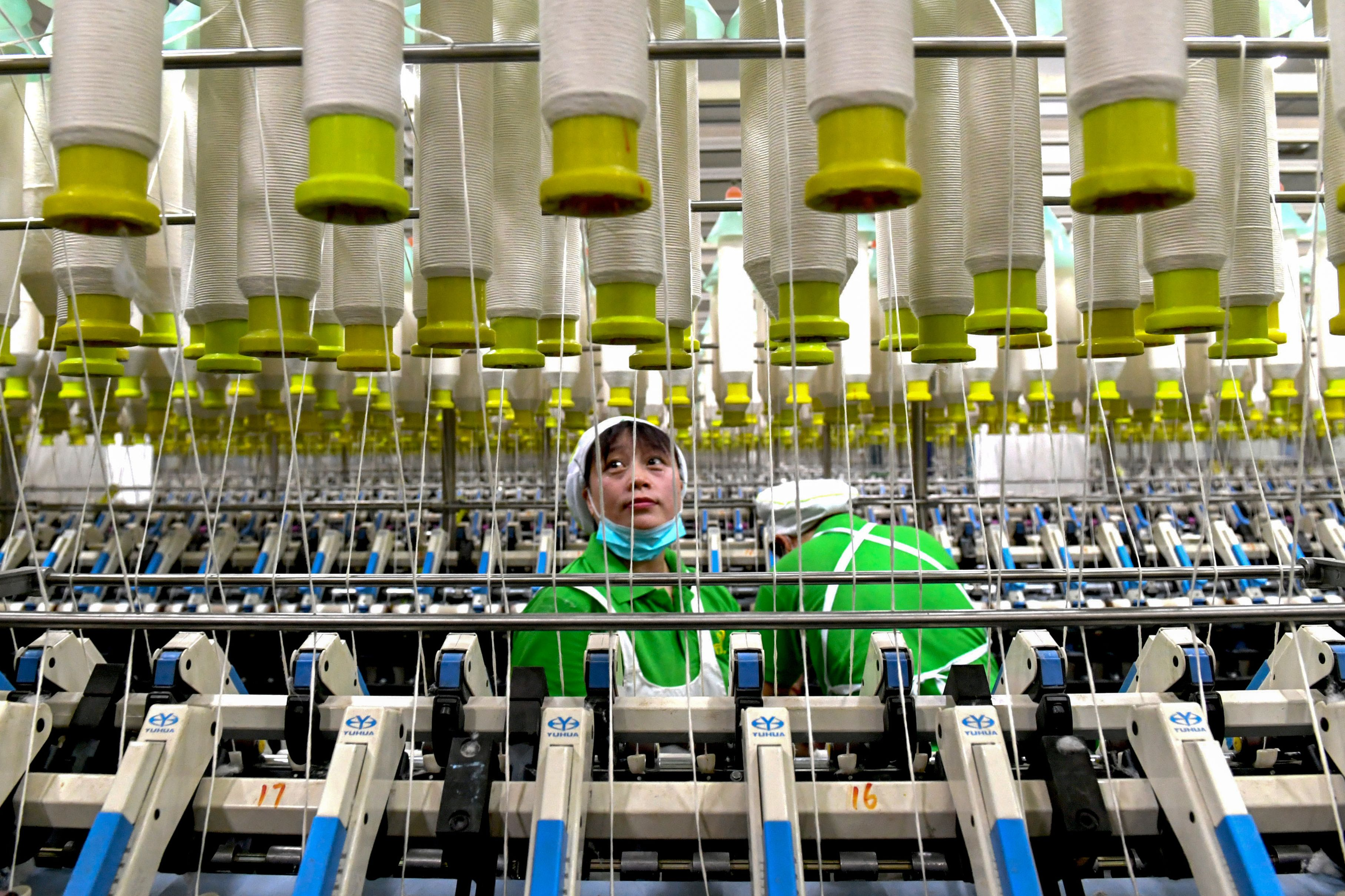 An employee works in a textile factory in Xiayi county in Shangqiu in China's central Henan province. (STR/AFP via Getty Images)