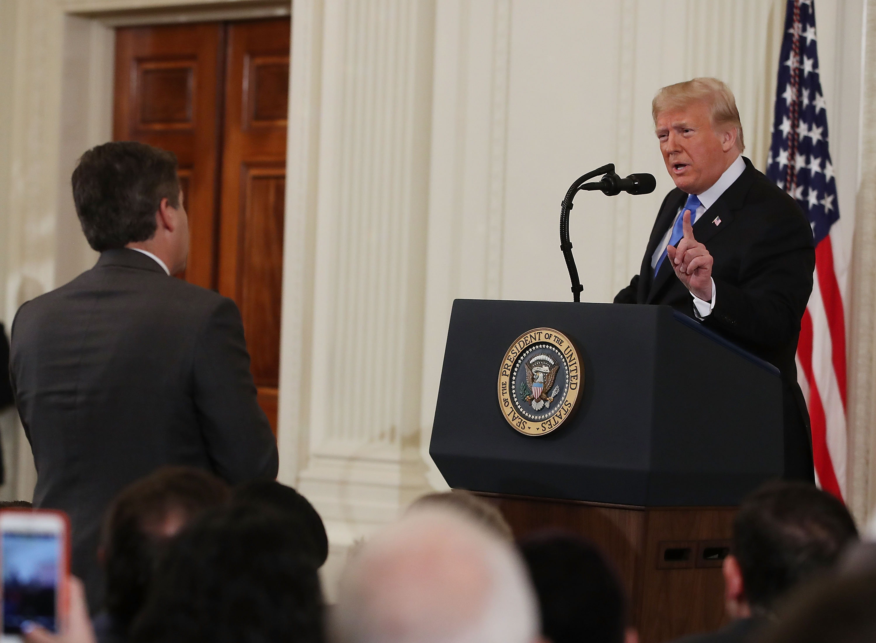 U.S. President Donald Trump gets into an exchange with Jim Acosta of CNN after giving remarks a day after the midterm elections on November 7, 2018 in the East Room of the White House in Washington, DC. (Mark Wilson/Getty Images)