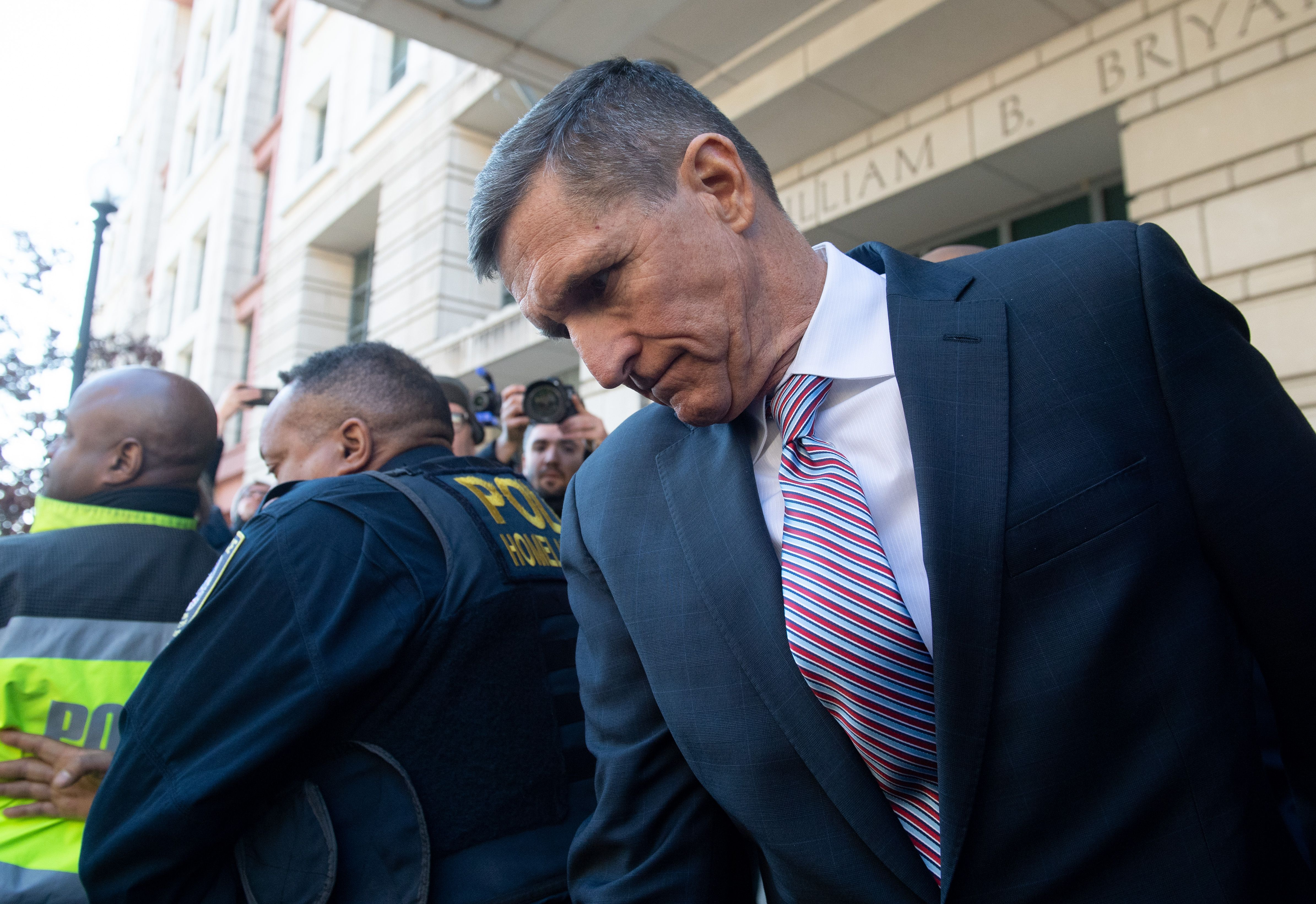 "Former National Security Advisor General Michael Flynn leaves after the delay in his sentencing hearing at US District Court in Washington, DC, December 18, 2018. - President Donald Trump's former national security chief Michael Flynn received a postponement of his sentencing after an angry judge threatened to give him a stiff sentence. Russia collusion investigation head Robert Mueller had proposed Flynn receive no jail time for lying to investigators about his Moscow ties. But Judge Emmet Sullivan said Flynn had behaved in a ""traitorous"" manner and gave the former three-star general the option of receiving a potentially tough prison sentence now -- or wait until Mueller's investigation was closer to being completed to better demonstrate his cooperation with investigators. (Photo by SAUL LOEB / AFP) (Photo credit should read SAUL LOEB/AFP via Getty Images)"