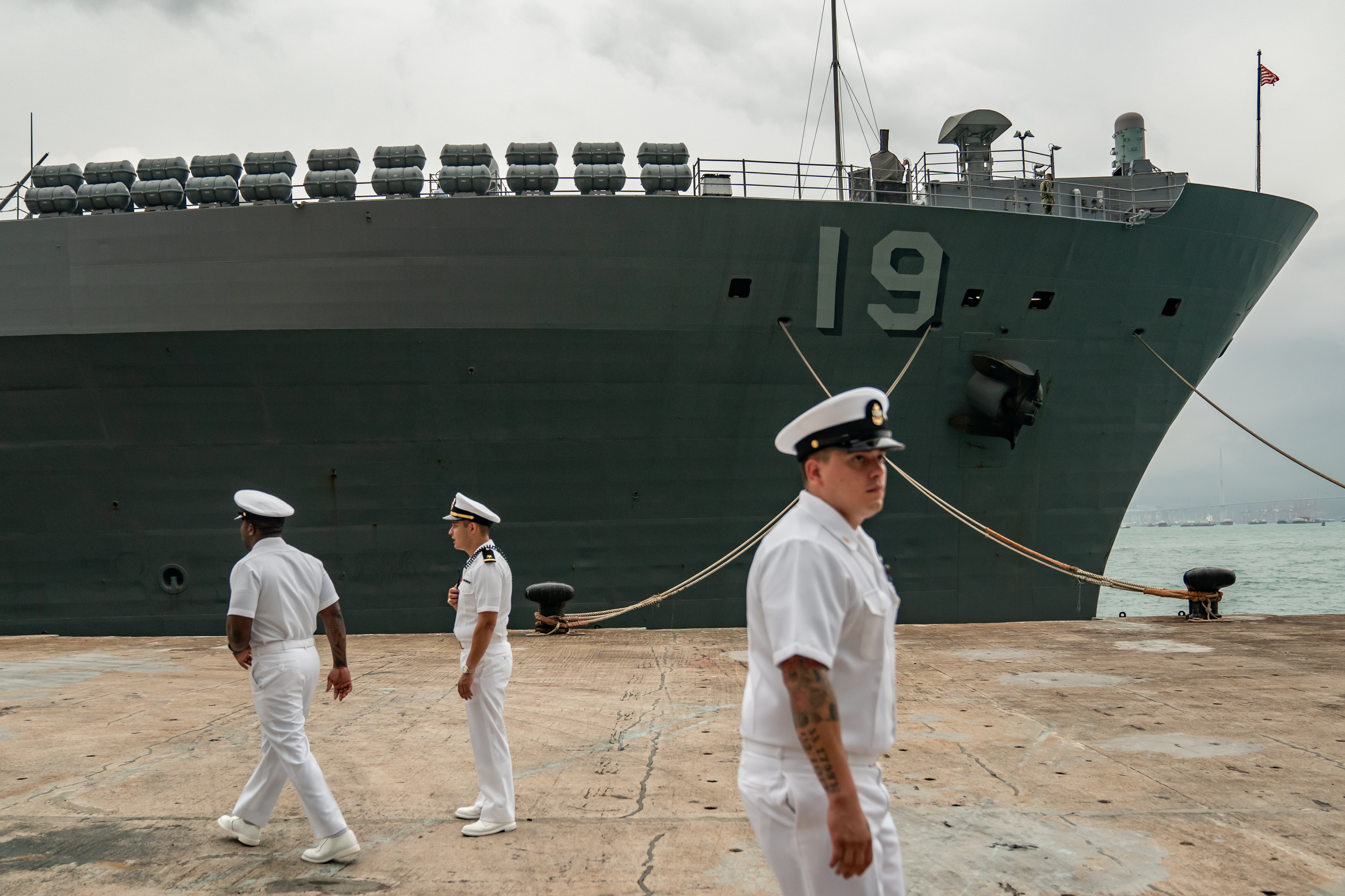 Navy crew members walks in front of the USS Blue Ridge at a wharf during a port call on April 20, 2019 in Hong Kong, China. (Anthony Kwan/Getty Images)
