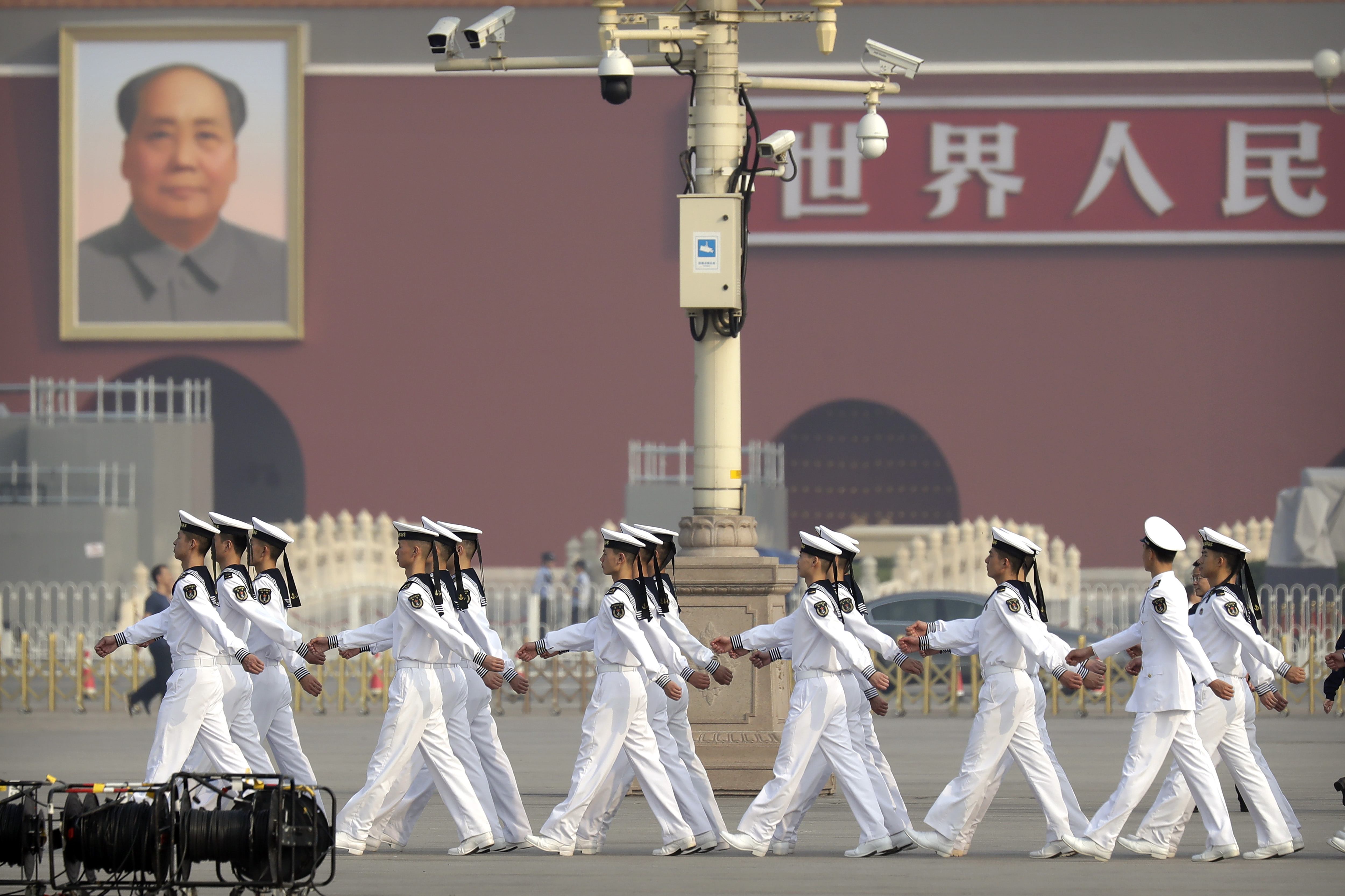 Cadets from China's People's Liberation Army (PLA) Navy march in formation before a ceremony to mark Martyr's Day at Tiananmen Square in Beijing, Monday, Sept. 30, 2019. (Mark Schiefelbein - Pool/Getty Images)