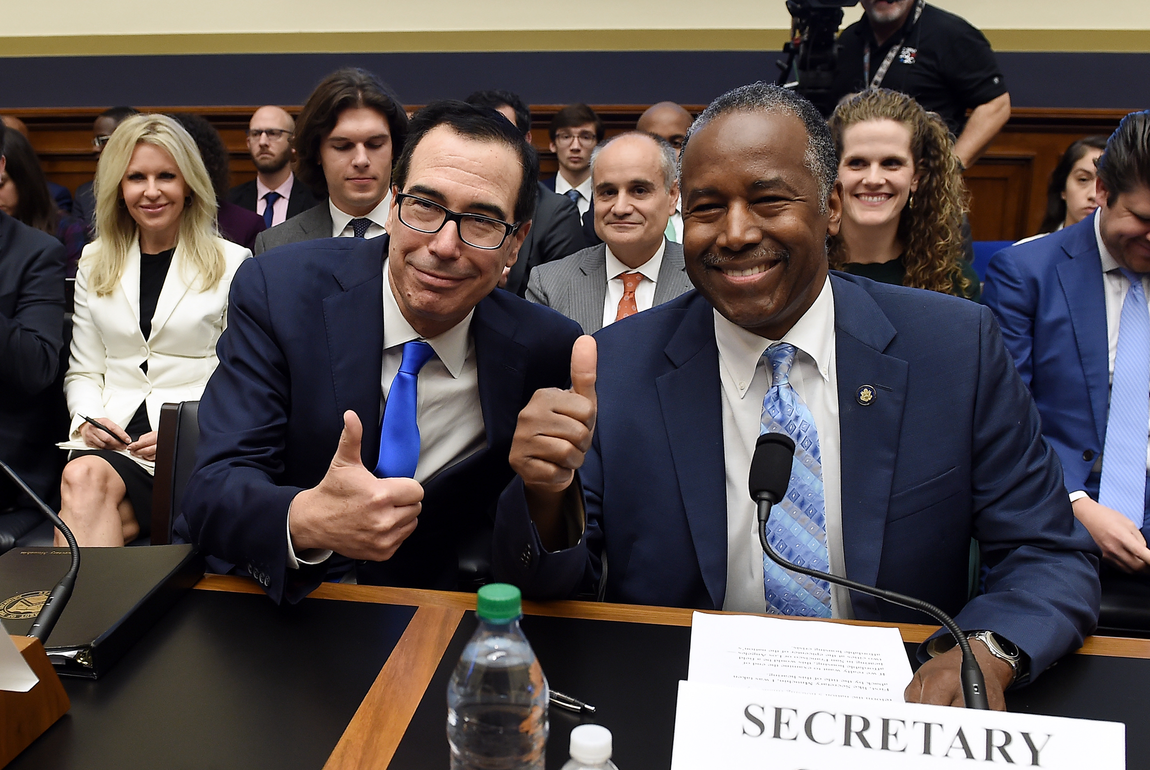 US Treasury Secretary Steven Mnuchin (L) and Secretary of the Department of Housing and Urban Development Ben Carson take their seats as they arrive for a House Financial Services Committee hearing, on Capitol Hill, October 22, 2019 in Washington, DC. (Photo by OLIVIER DOULIERY/AFP via Getty Images)