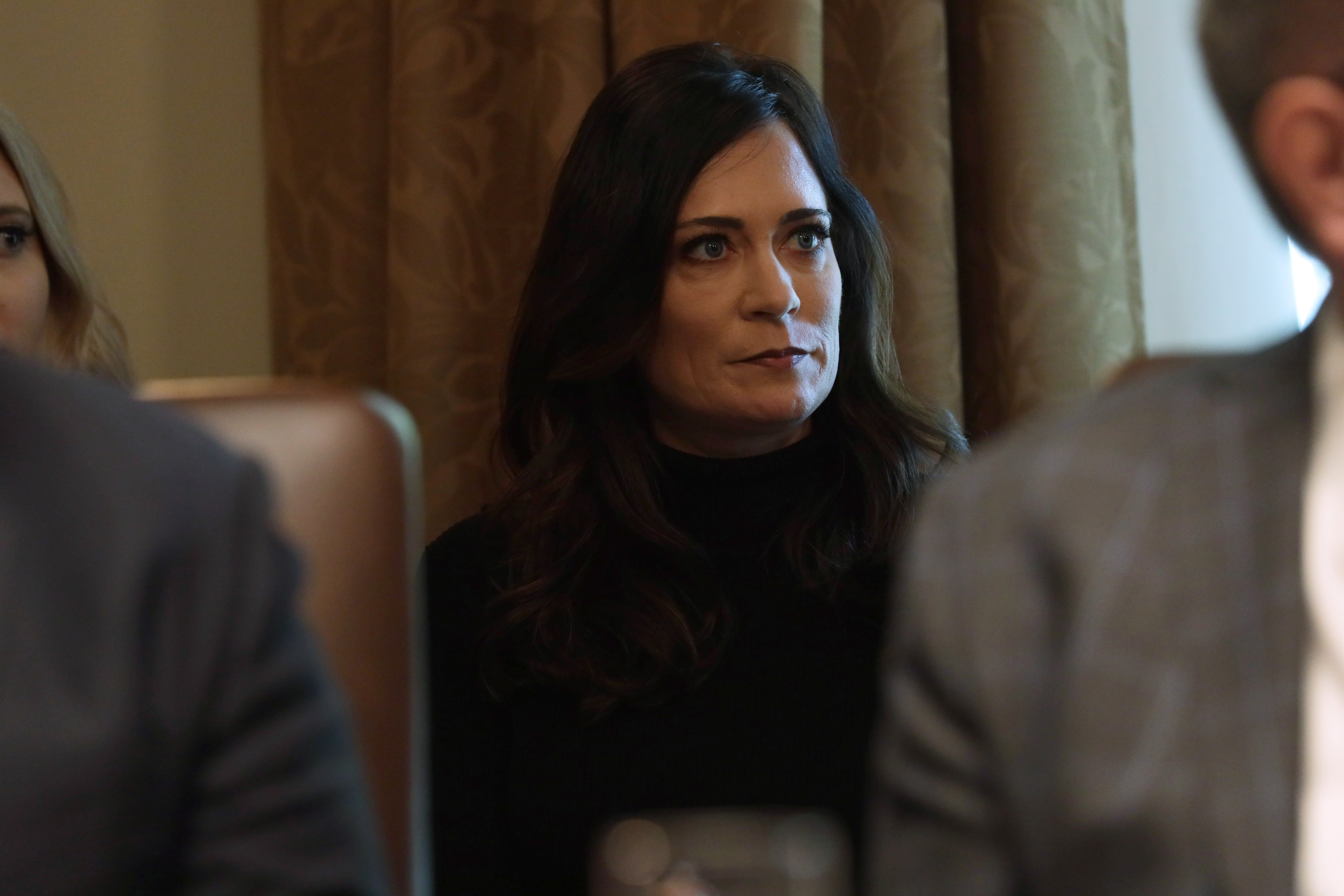 WASHINGTON, DC - OCTOBER 21: White House Press Secretary and Communications Director Stephanie Grisham listens during a cabinet meeting in the Cabinet Room of the White House October 21, 2019 in Washington, DC. President Trump held a cabinet meeting to discuss his administration's agenda and made extensive remarks about impeachment and the situation on the Syrian/Turkish border. (Photo by Alex Wong/Getty Images)