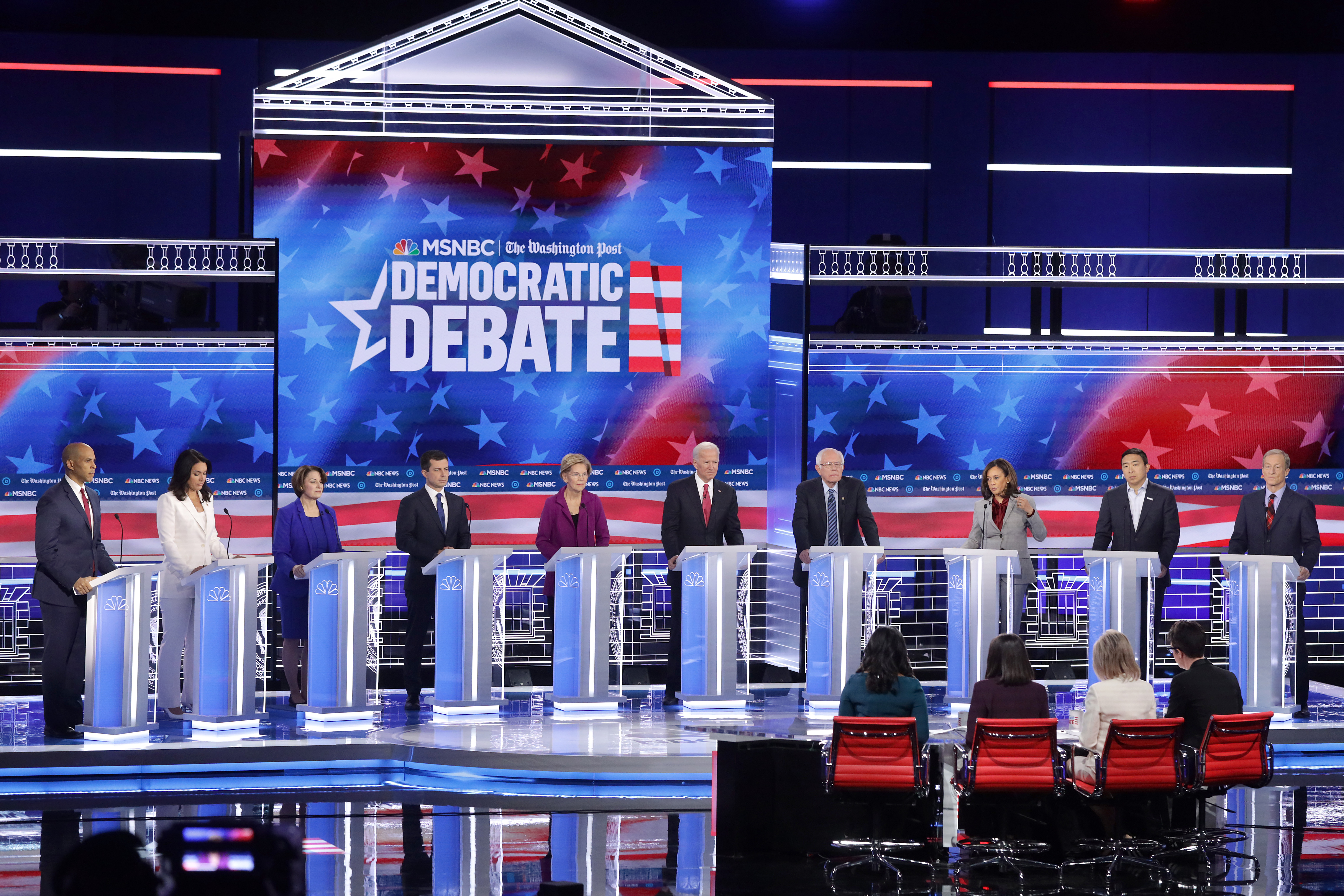 Democratic presidential candidates Sen. Cory Booker (D-NJ), Rep. Tulsi Gabbard (D-HI) , Sen. Amy Klobuchar (D-MN), South Bend, Indiana Mayor Pete Buttigieg, Sen. Elizabeth Warren (D-MA), Former Vice President Joe Biden, Sen. Bernie Sanders (I-VT), Sen. Kamala Harris (D-CA), Andrew Yang, and Tom Steyer participate in the fifth Democratic Presidential Debate. (Alex Wong/Getty Images)