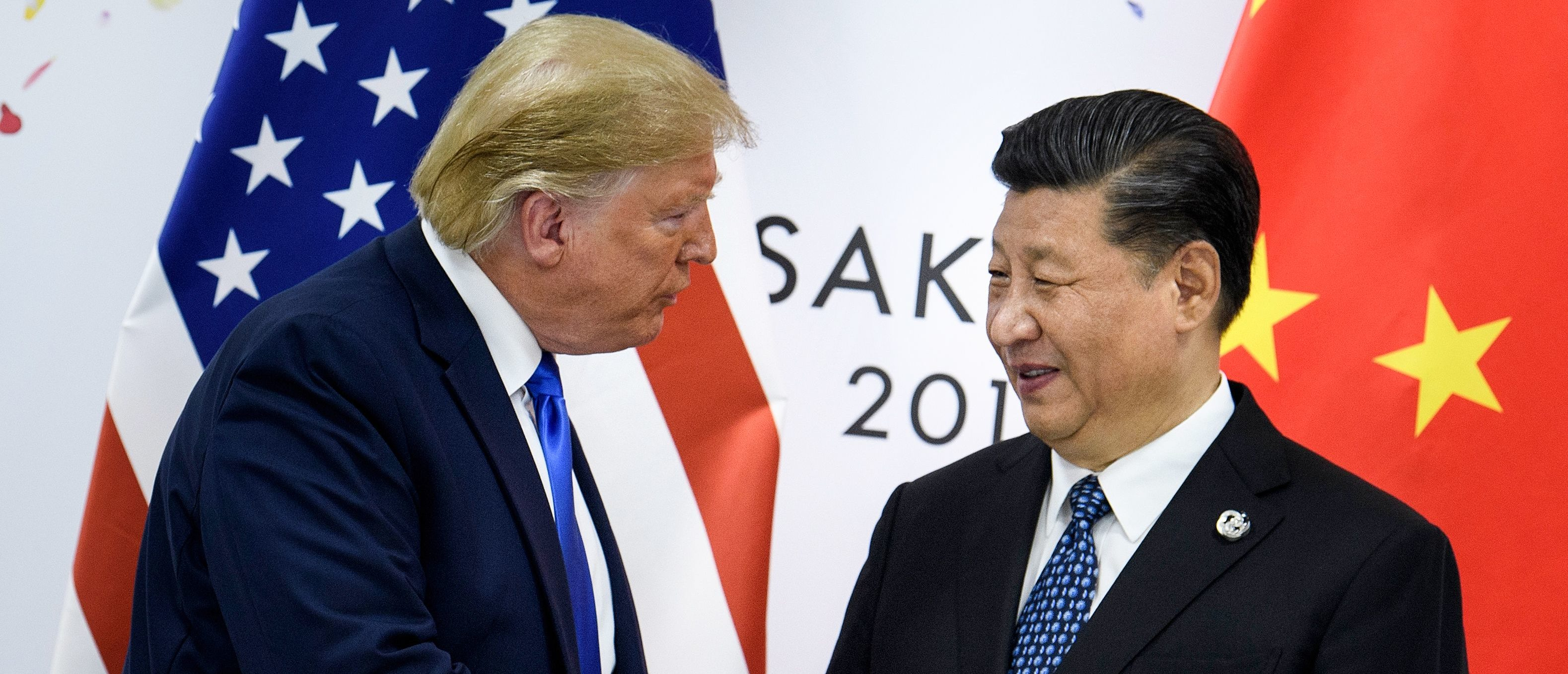 June 28, 2019 — China's President Xi Jinping (R) shakes hands with US President Donald Trump before a bilateral meeting on the sidelines of the G20 Summit in Osaka. - From the Arab Spring to bloodletting in Syria, from Obama to Trump, from terror in the streets of Paris to Brexit, the 2010s began with hope for a more equitable world, and end with a slide towards nationalistic populism. (Photo by BRENDAN SMIALOWSKI/AFP via Getty Images)